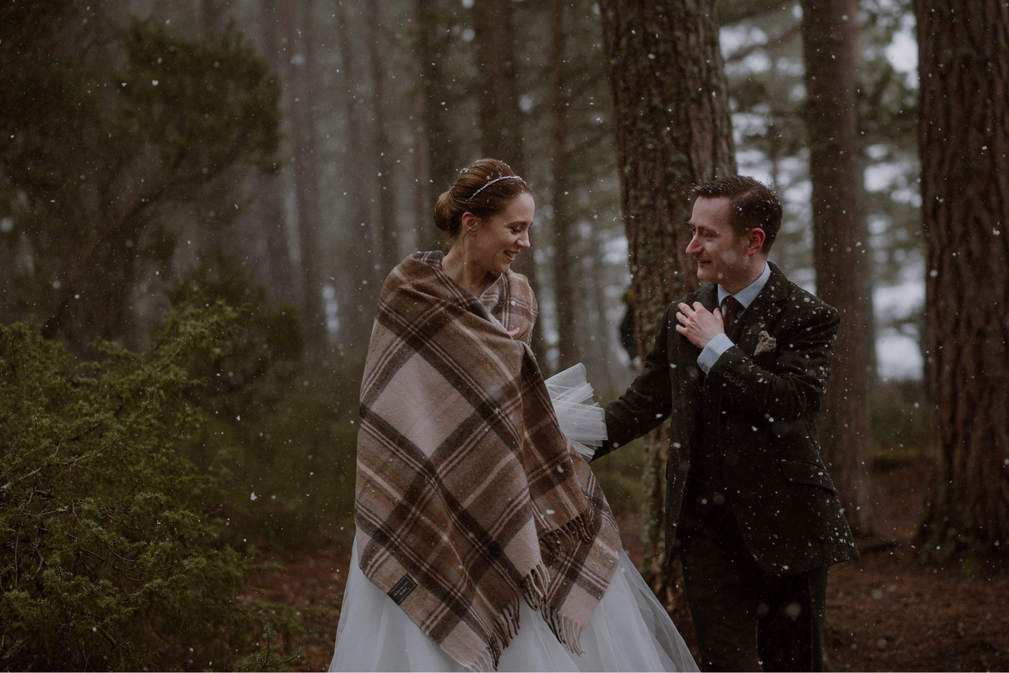 Just married in the snow Cairngorms forest