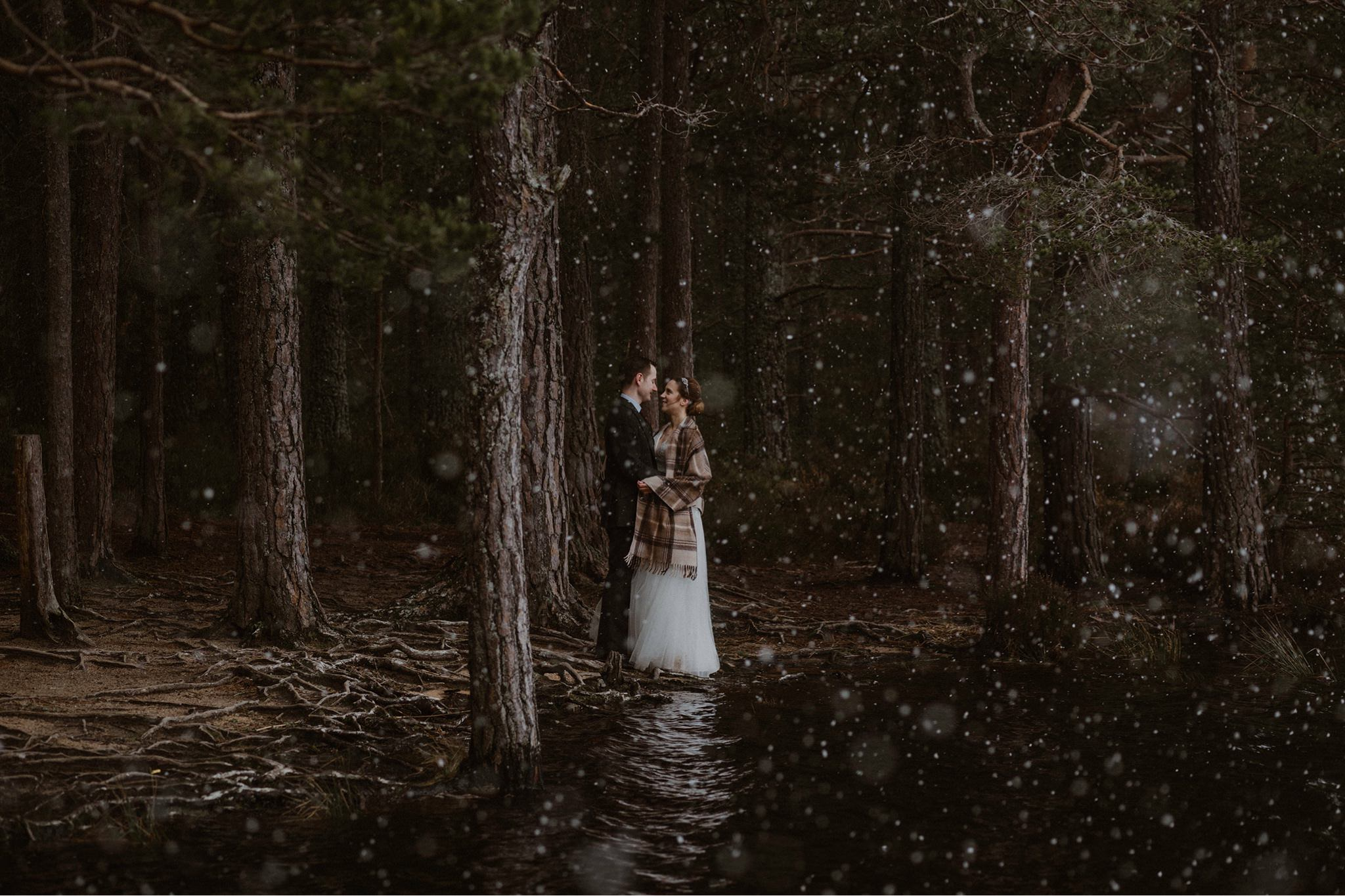 Elopement couple in the snow by Loch Garten Cairngorms