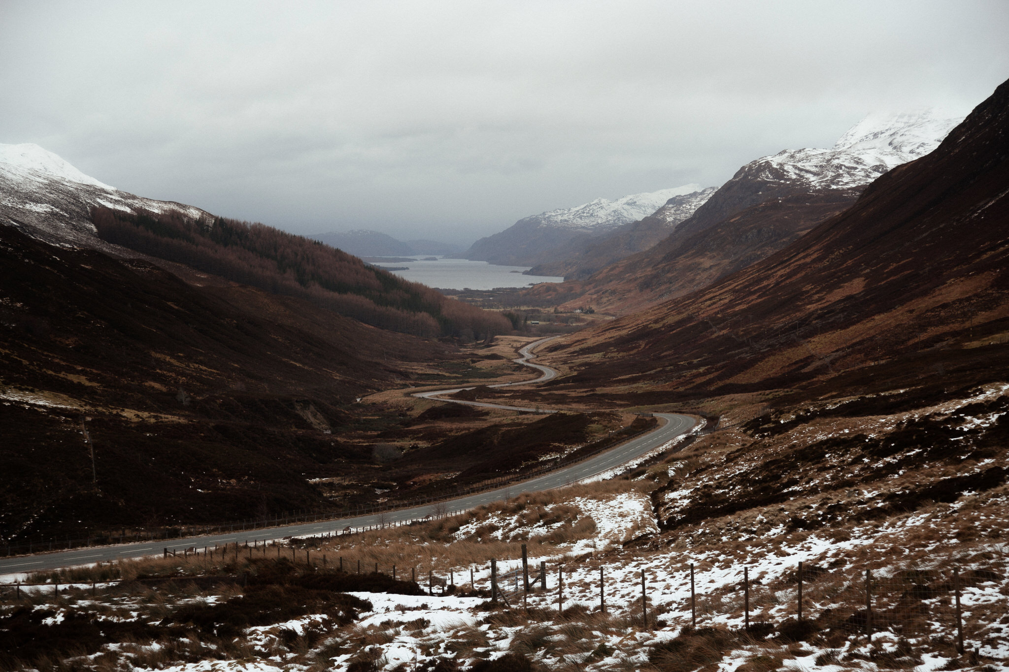 Elope in Scotland road running through mountains Wester Ross