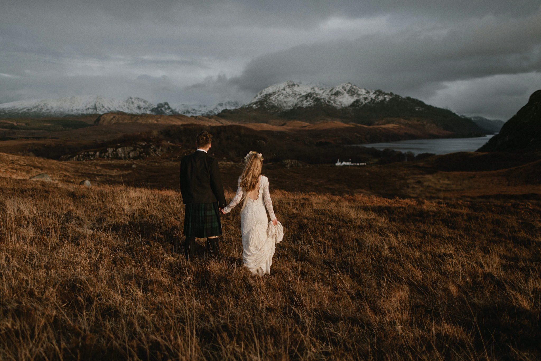 Scottish elopement couple on hillside in Wester Ross at sunset