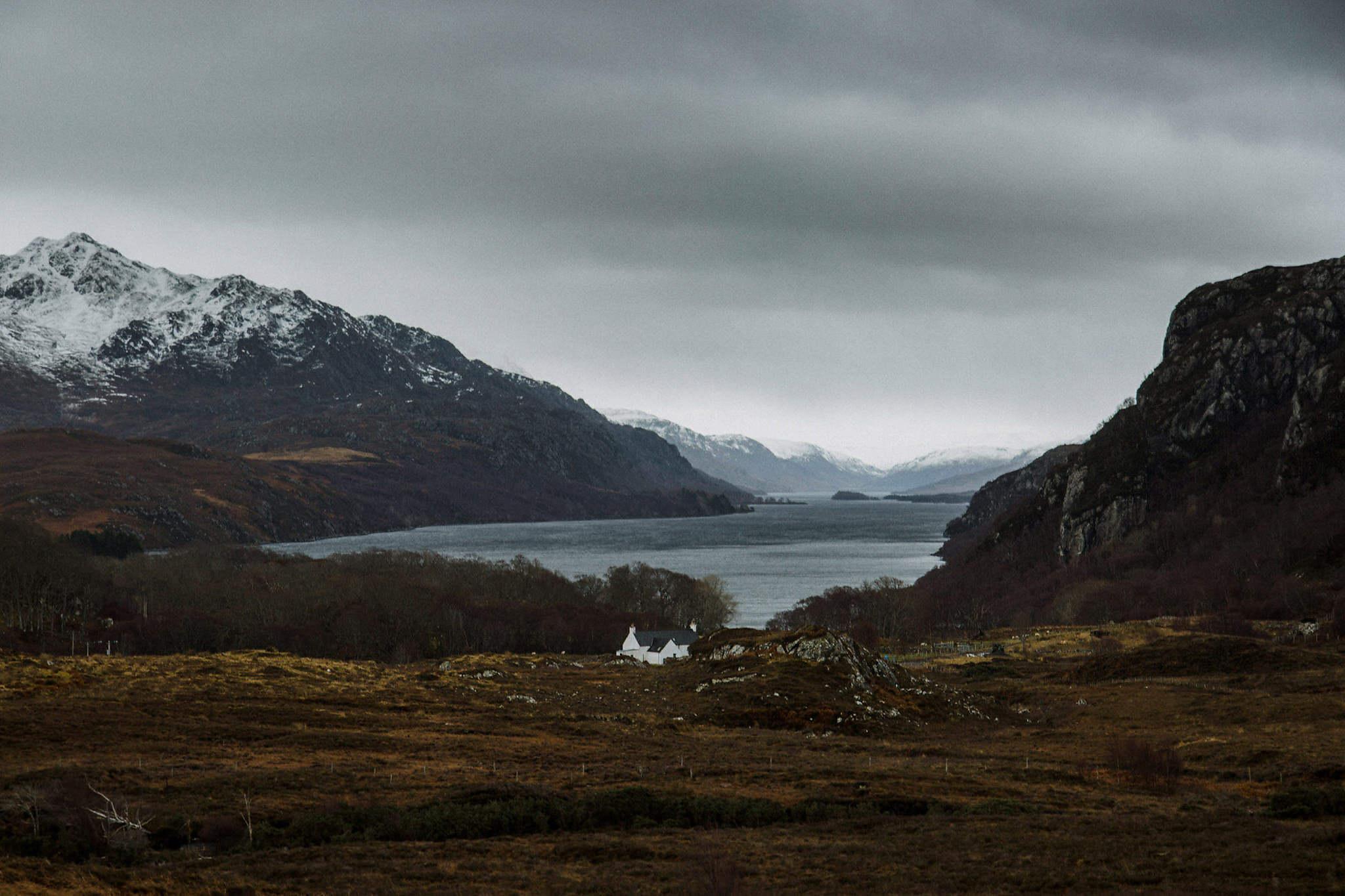 Elope in Scotland Scottish landscape Loch Maree and cottage in winter