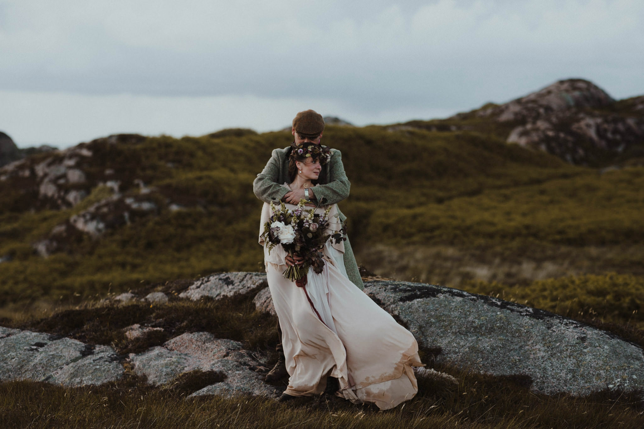 Elope in Scotland married couple on hillside in the Isle of Mull