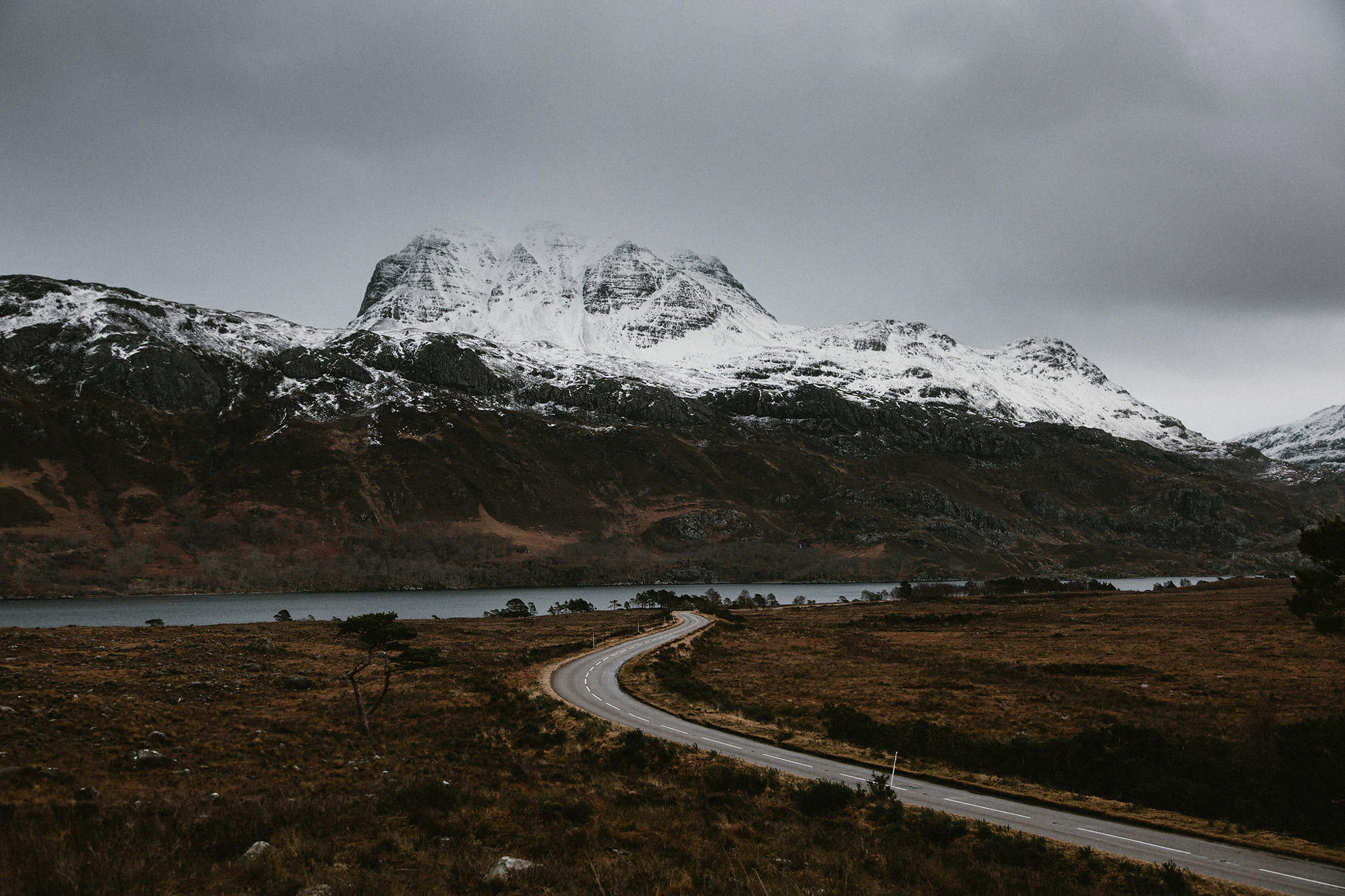 Elopement locations in Scotland Wester Ross landscape road running through snow covered mountains