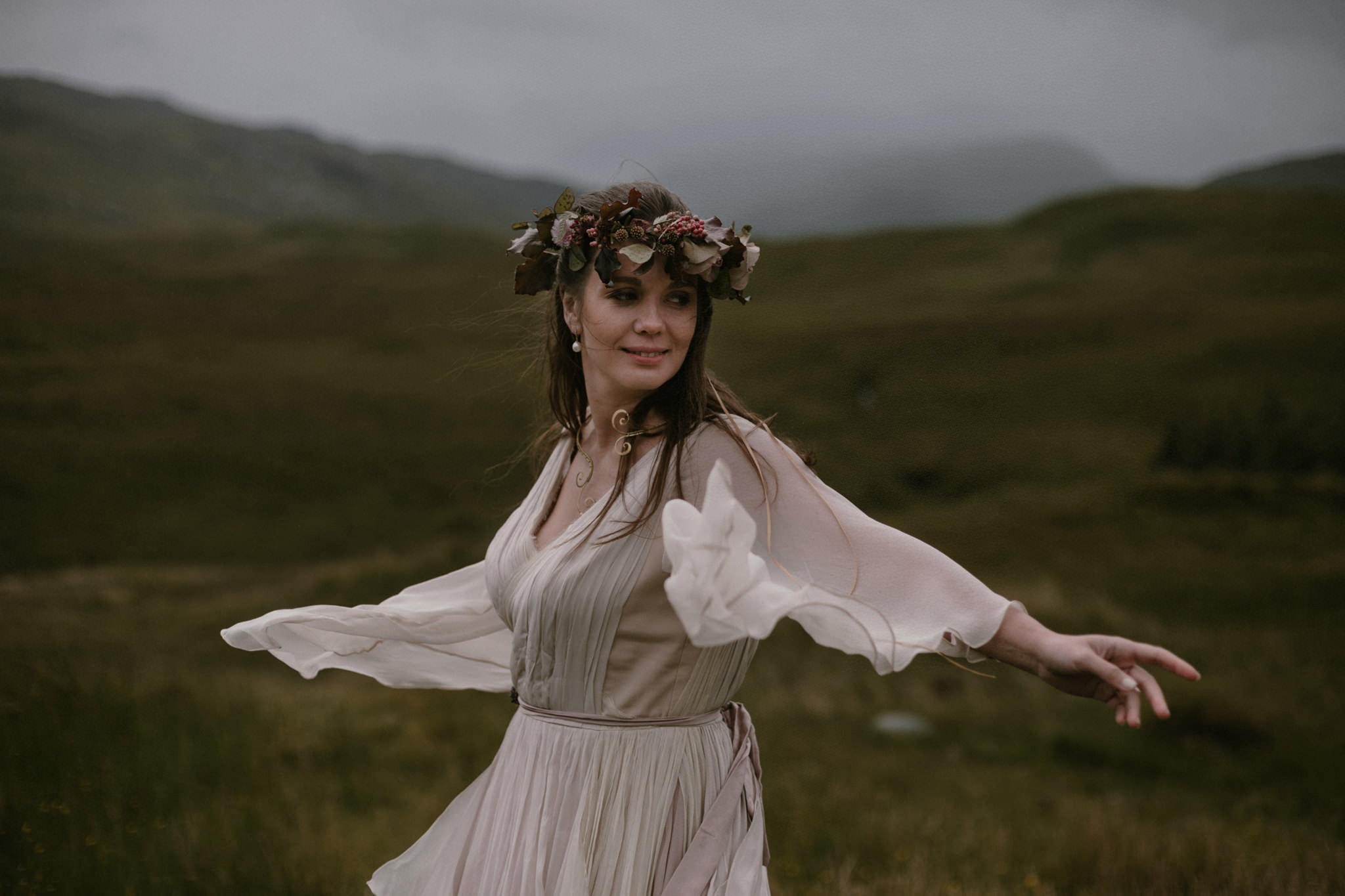 Scottish elopement bride wearing flower crown on hillside on the Isle of Mull