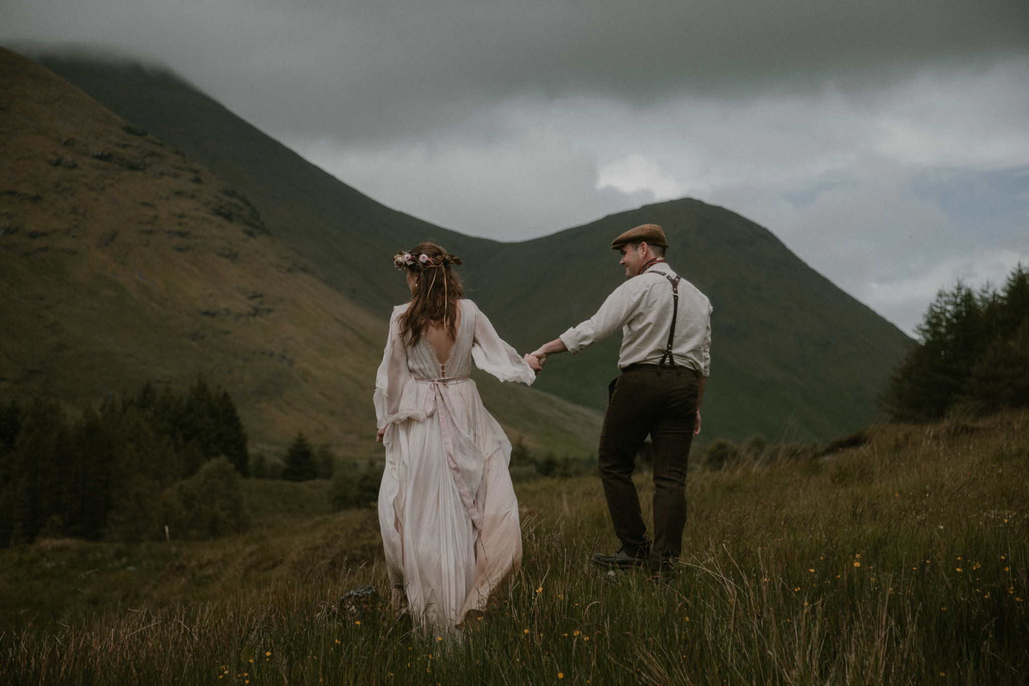 Scottish elopement couple walking away amidst the mountains on the Isle of Mull in Scotland