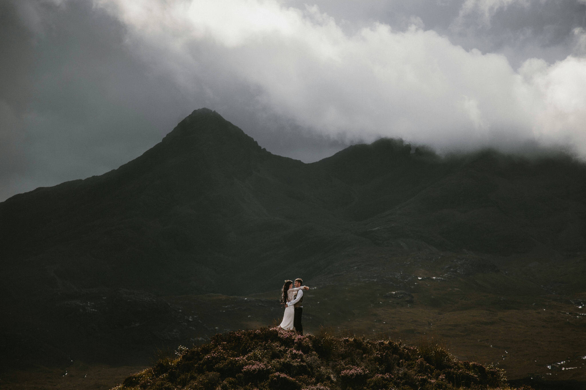 Isle of Skye elopement couple embracing in the mountains