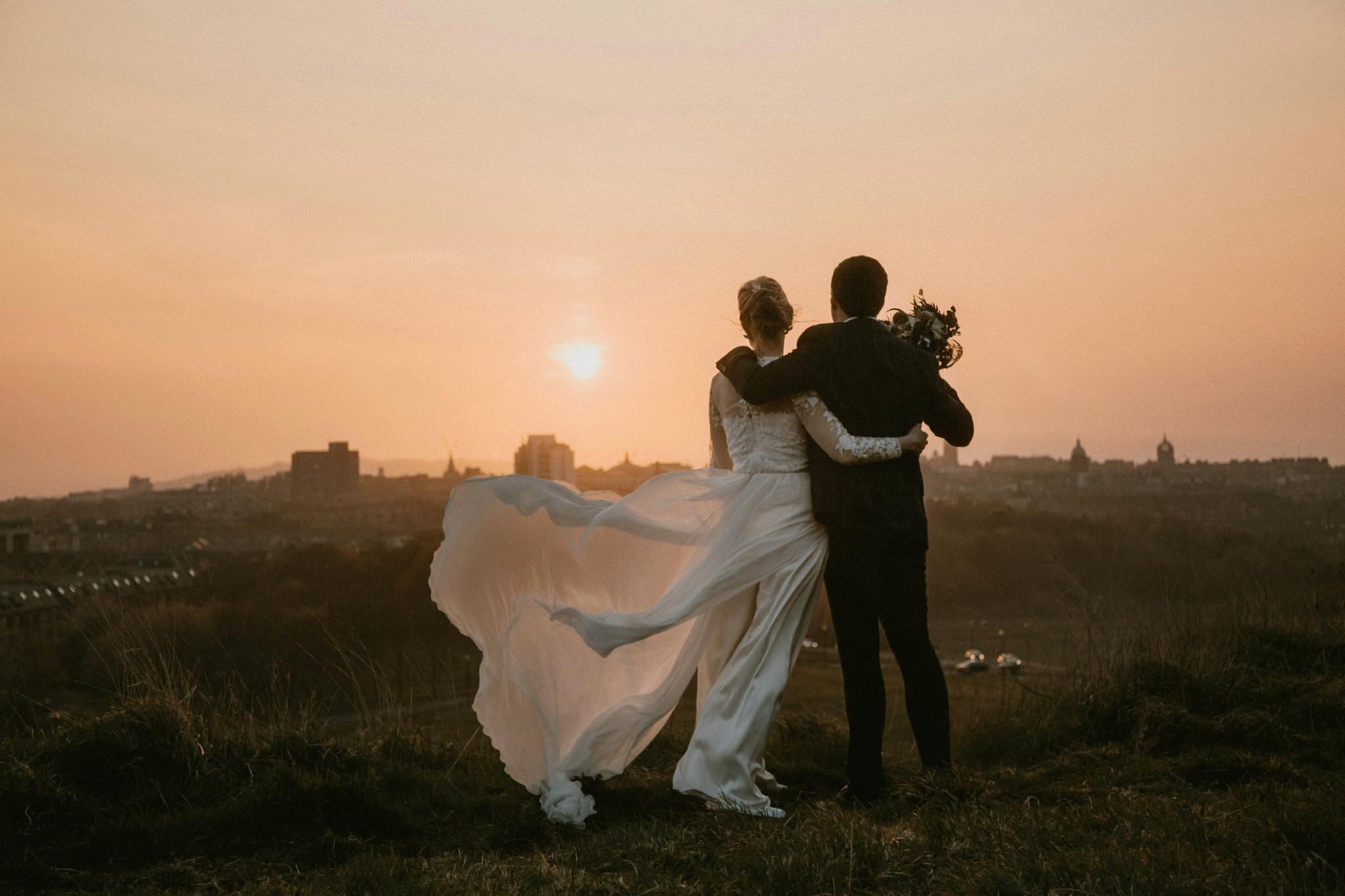 Scottish elopement couple watch sunset over Edinburgh from Arthur's Seat