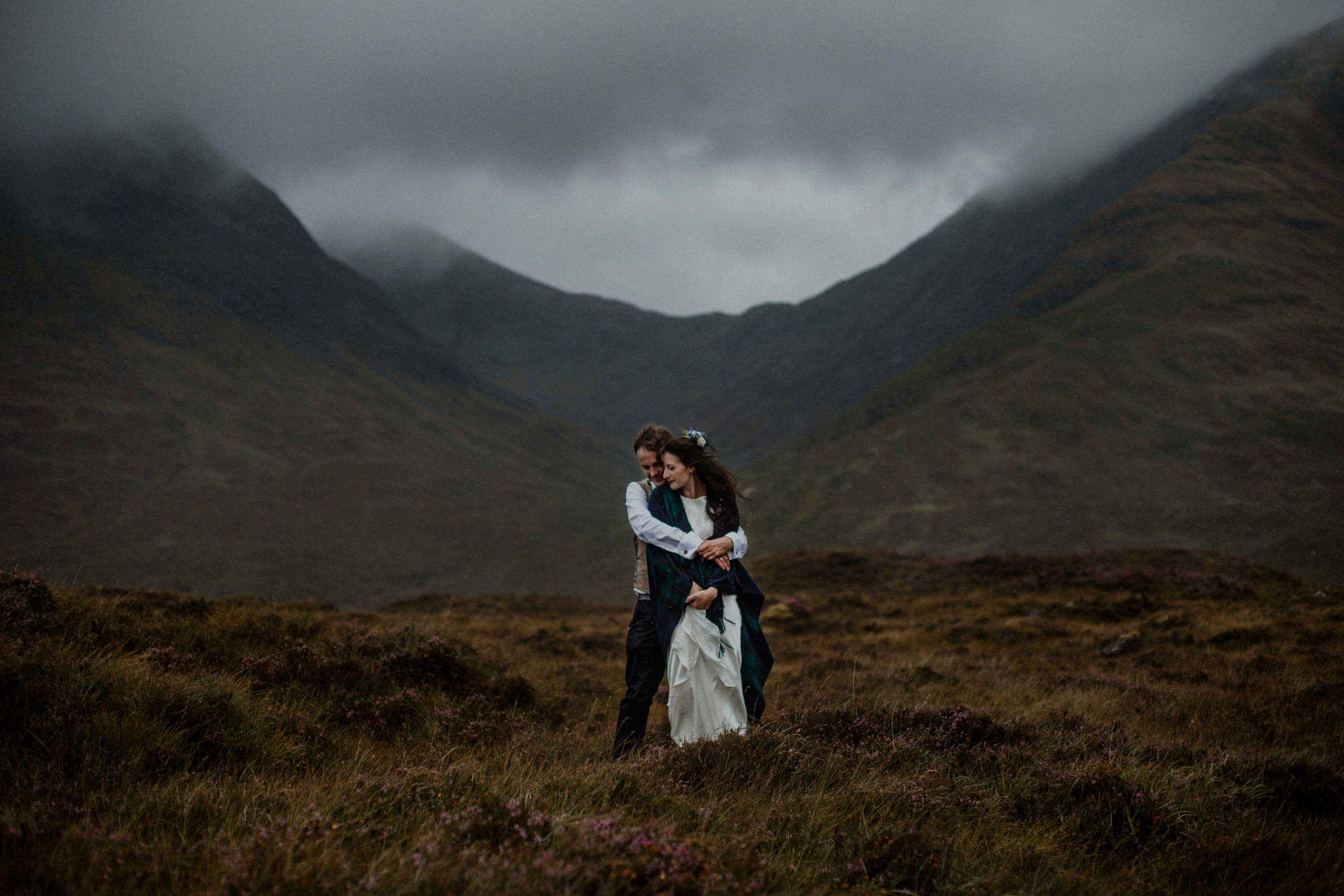 A warm embrace against the weather - husband and wife on the Isle of Skye
