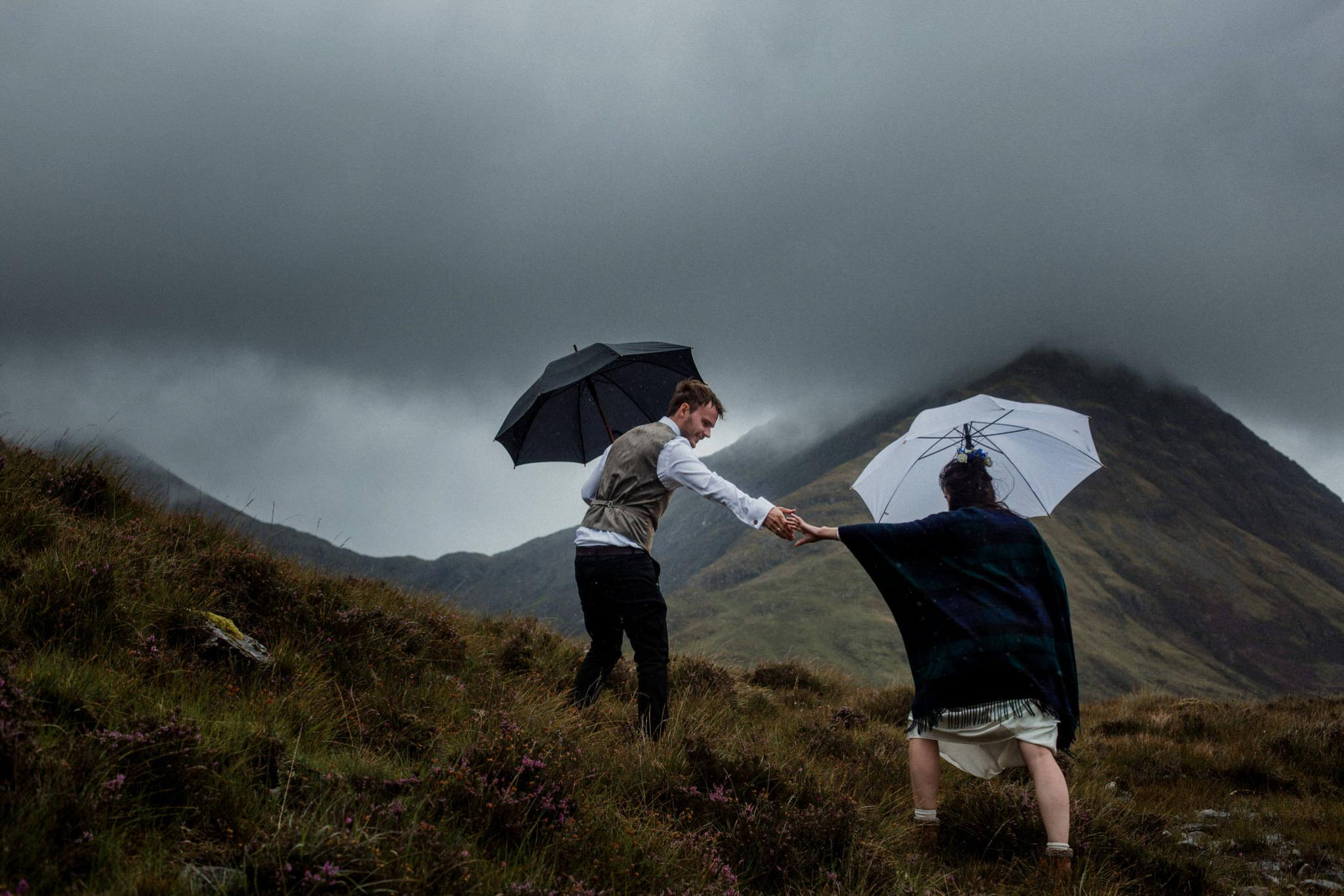 A husband and wife who eloped to Skye brave the weather with umbrellas