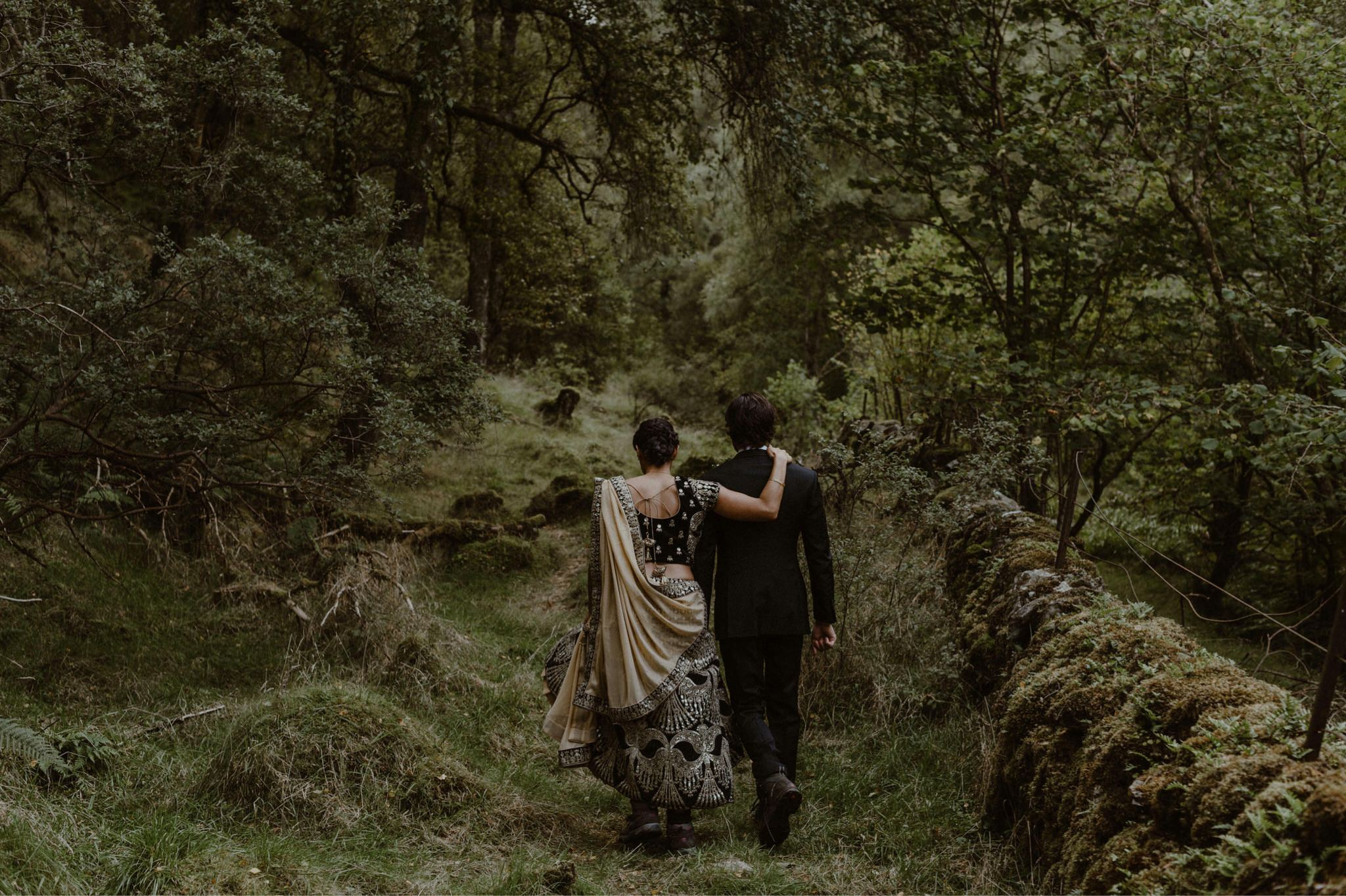 Husband and wife take a walk in the woods