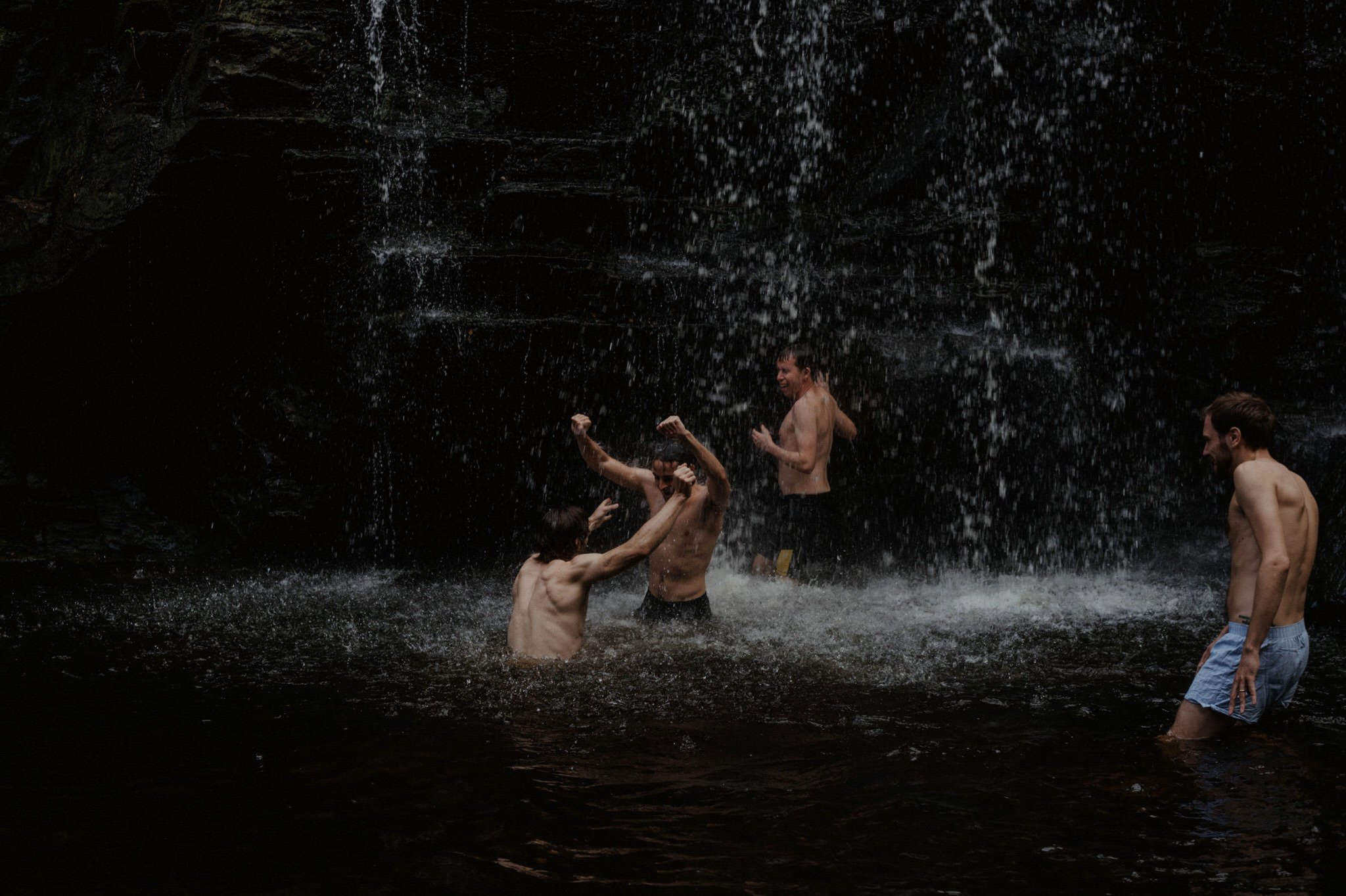 Groomsmen wild swimming after a wedding
