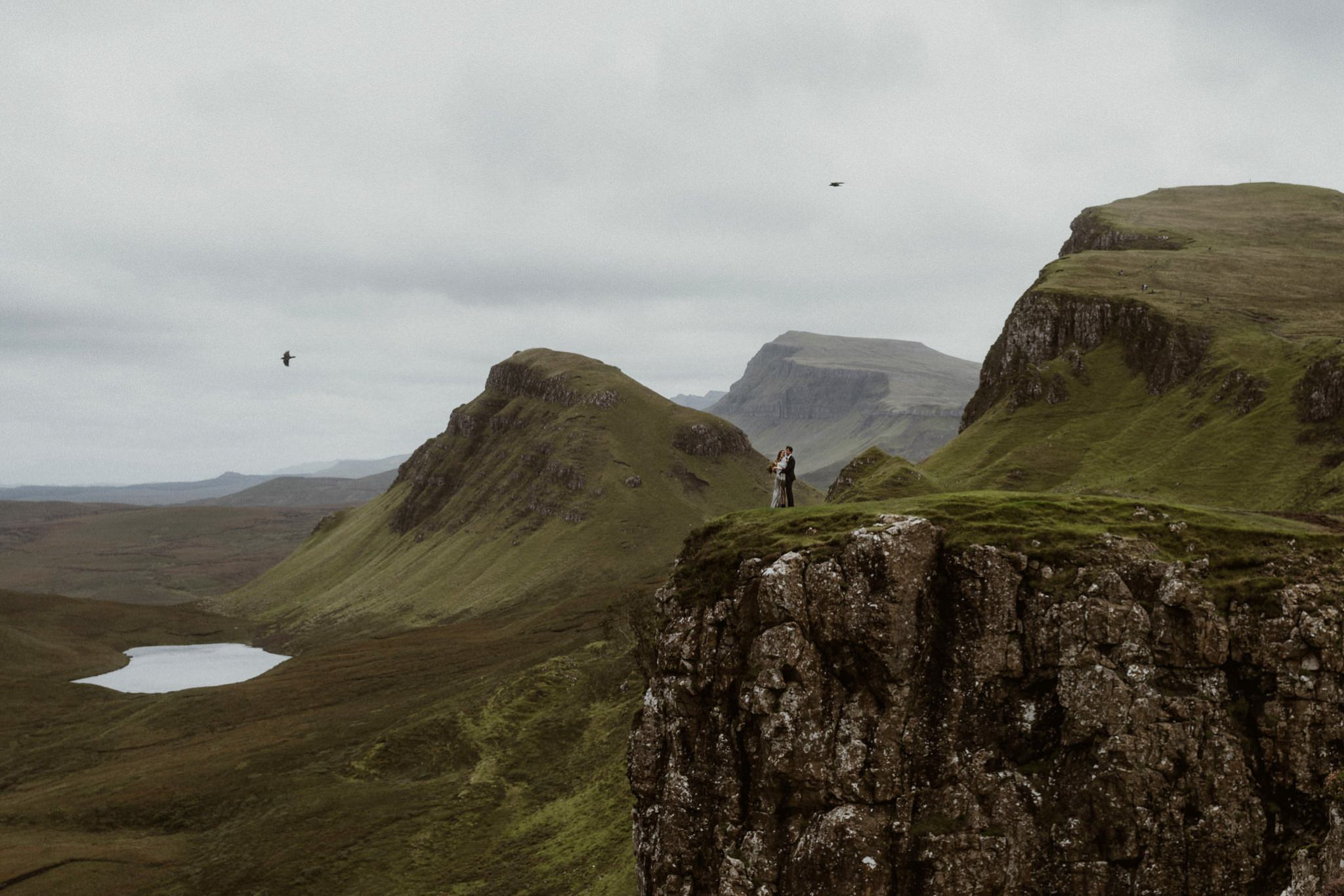 A couple on a headland near the Quiraing on the Isle of Skye