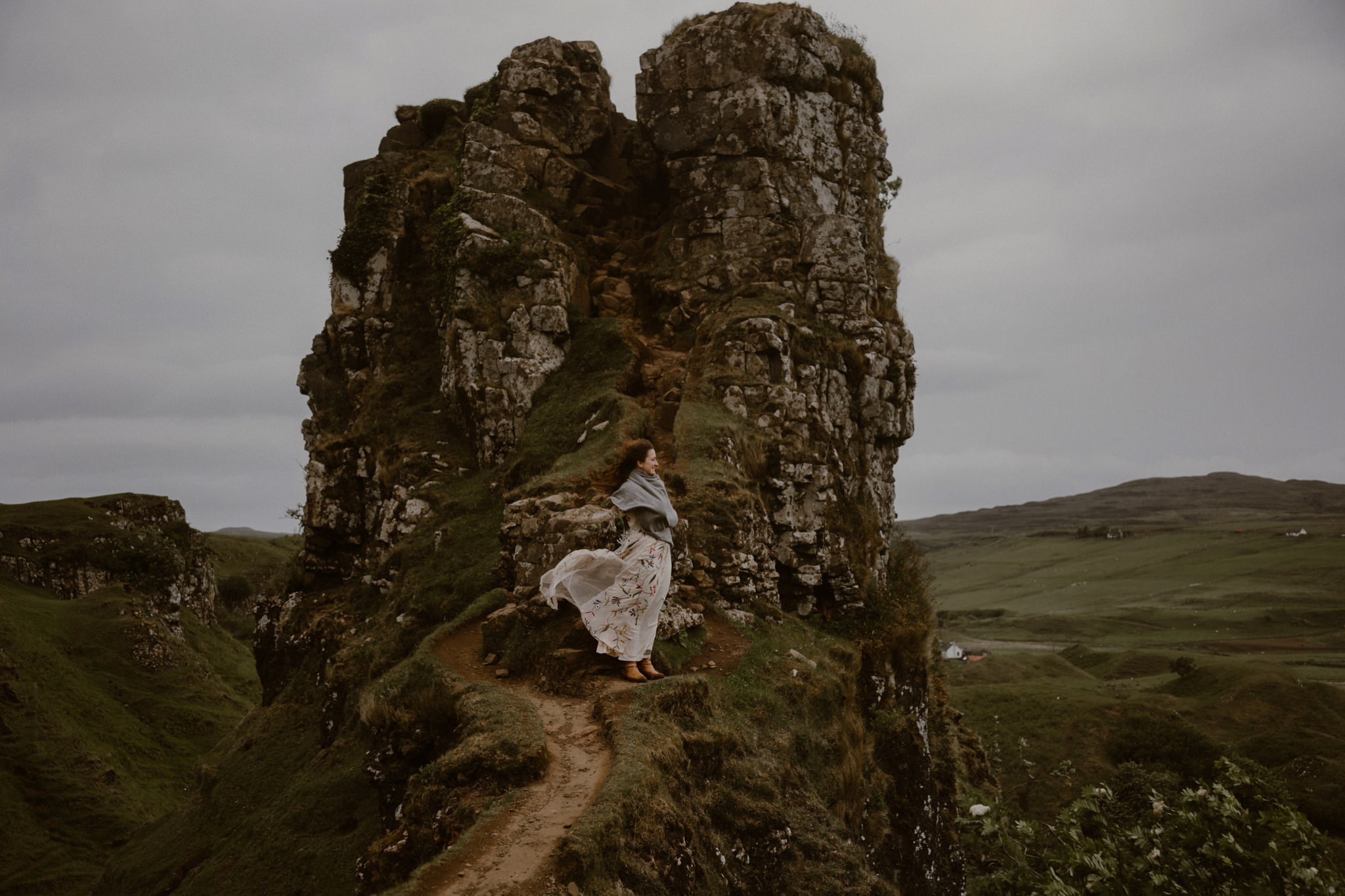 A bride stands at the Tower in Fairy Glen on the Isle of Skye