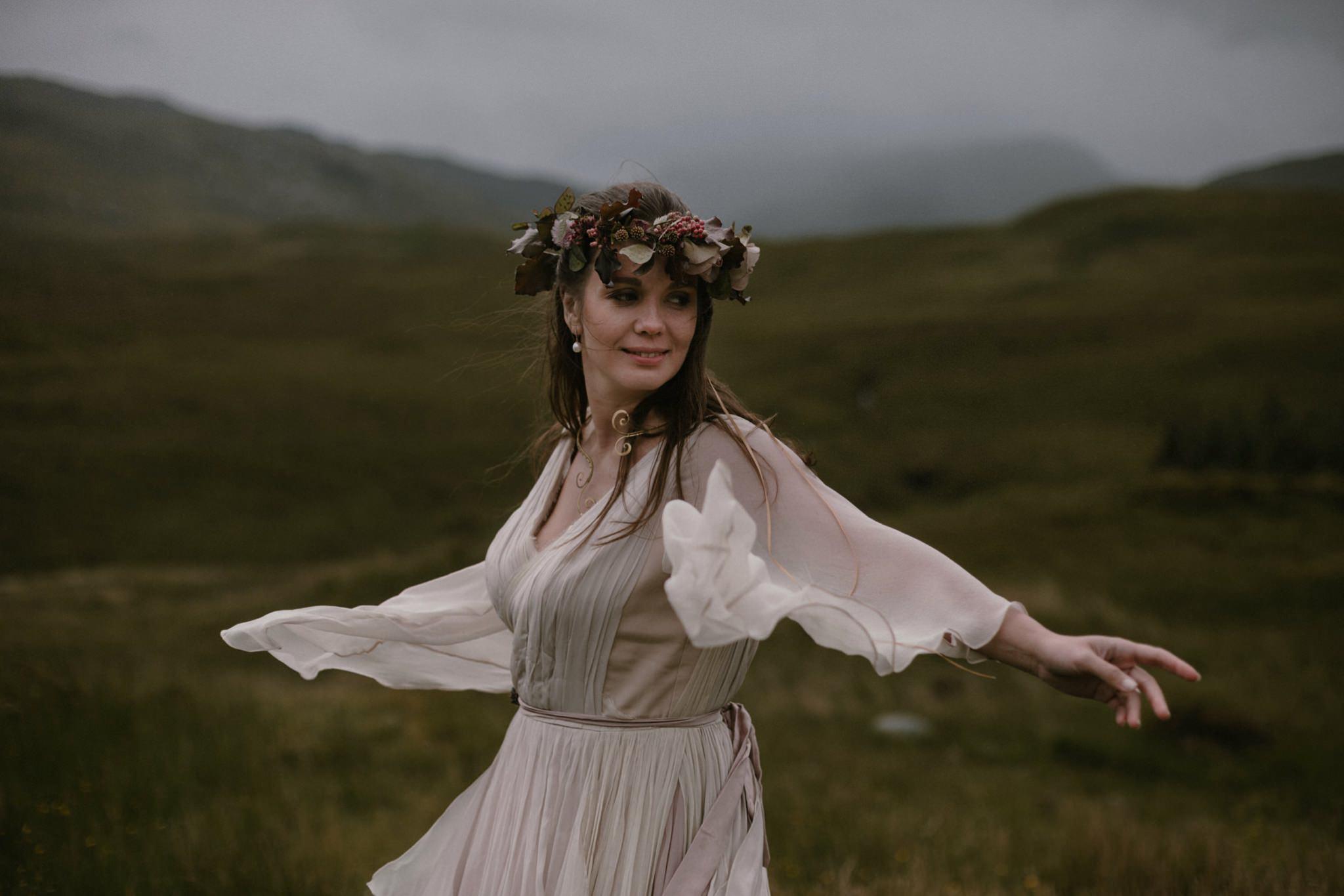 A bride enjoys her floaty dress in the Scottish landscape