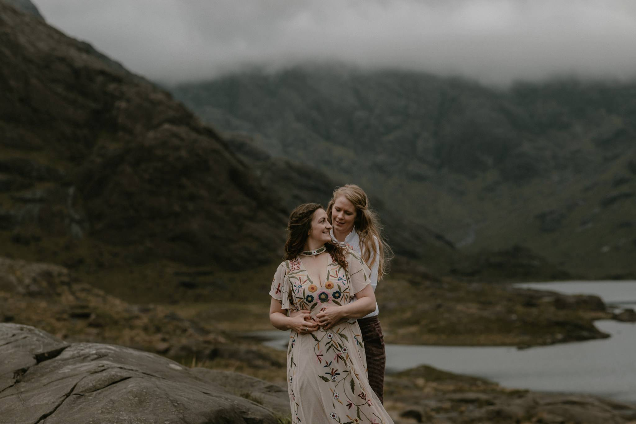 Wife and wife embracing on the shores of Loch Coruisk on the Isle of Skye