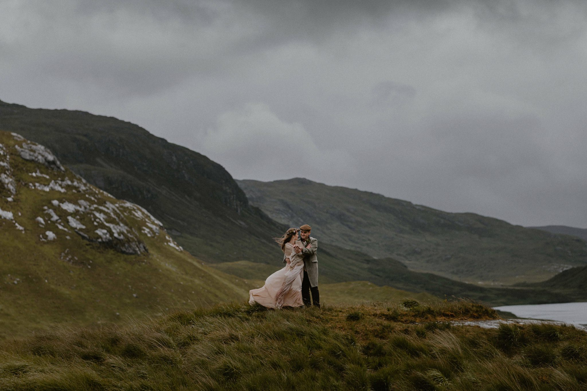 A new husband and wife braving the winds on the Inner Hebrides of Scotland