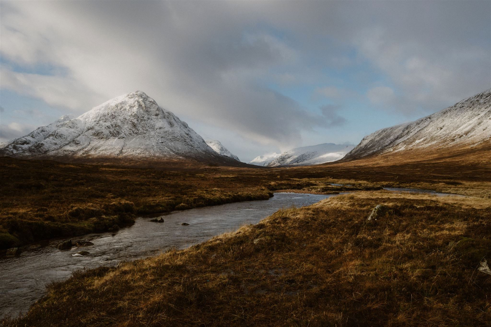 Mountain and river landscape in Glencoe in the Highlands of Scotland