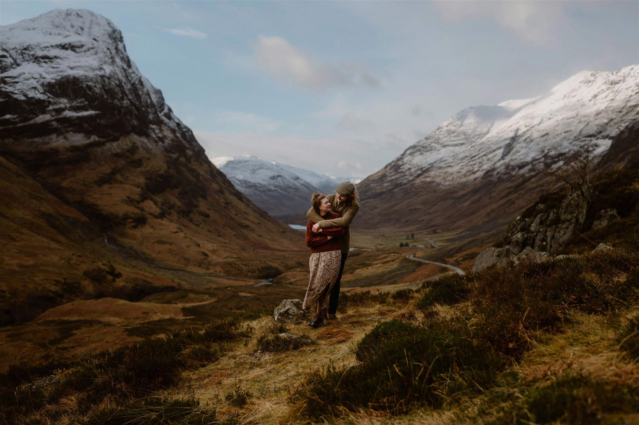 Elopement wedding couple embrace in front of the mountains in Glencoe Scotland