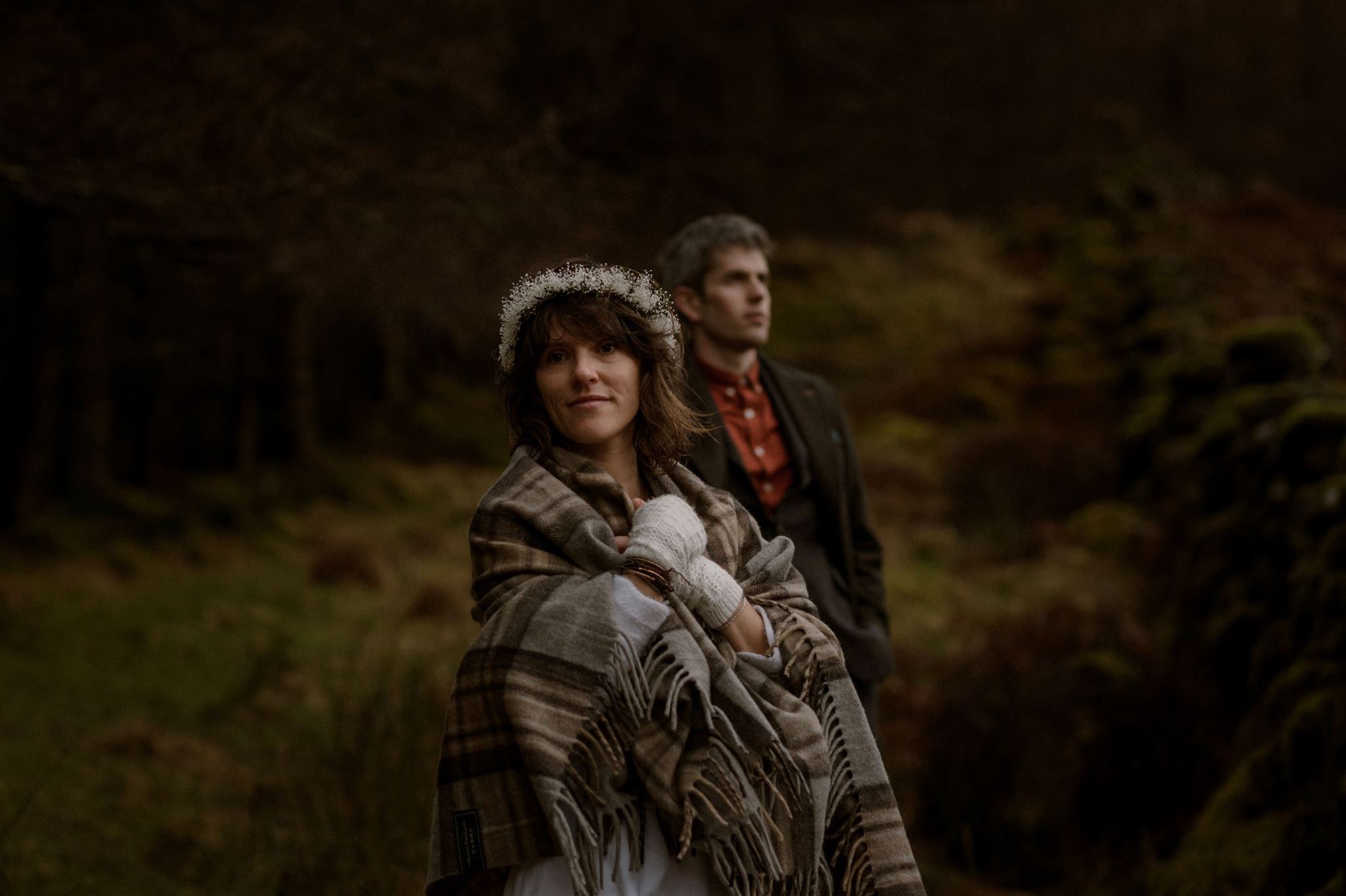 Scotland elopement wedding couple ready for their Scottish elopement wedding in walking boots and tartan blanket