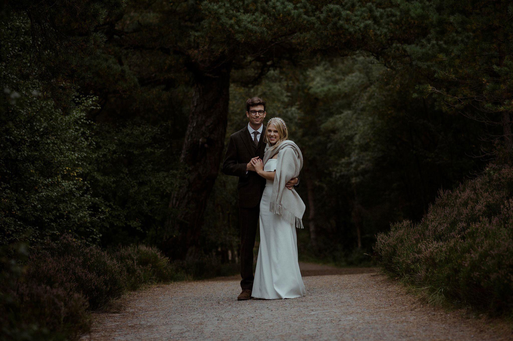 Couple under a tree while at Cairngorms elopement wedding at Loch Garten Scottish Highland
