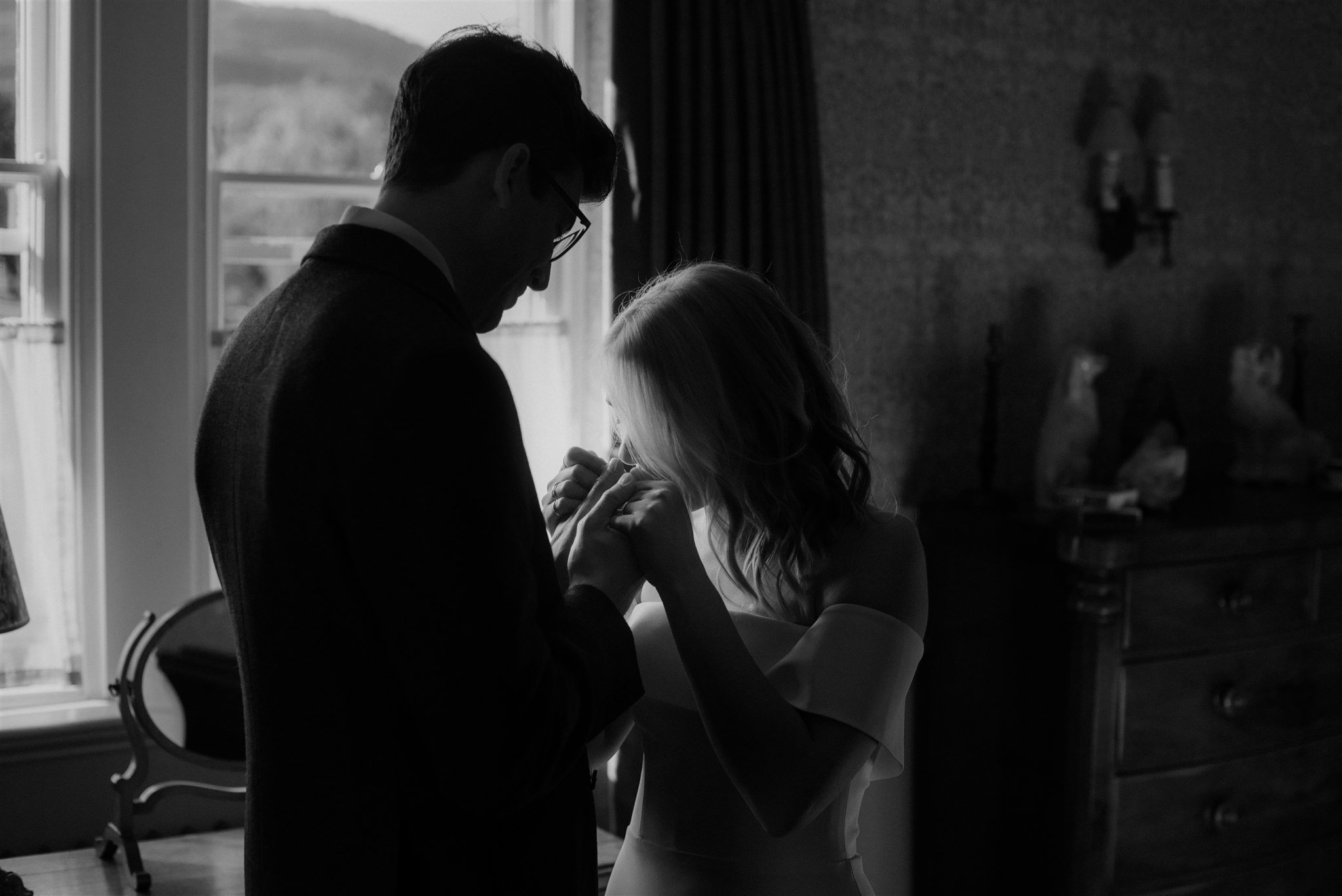 Bride and groom in a bedroom at The Fife Arms in Braemar