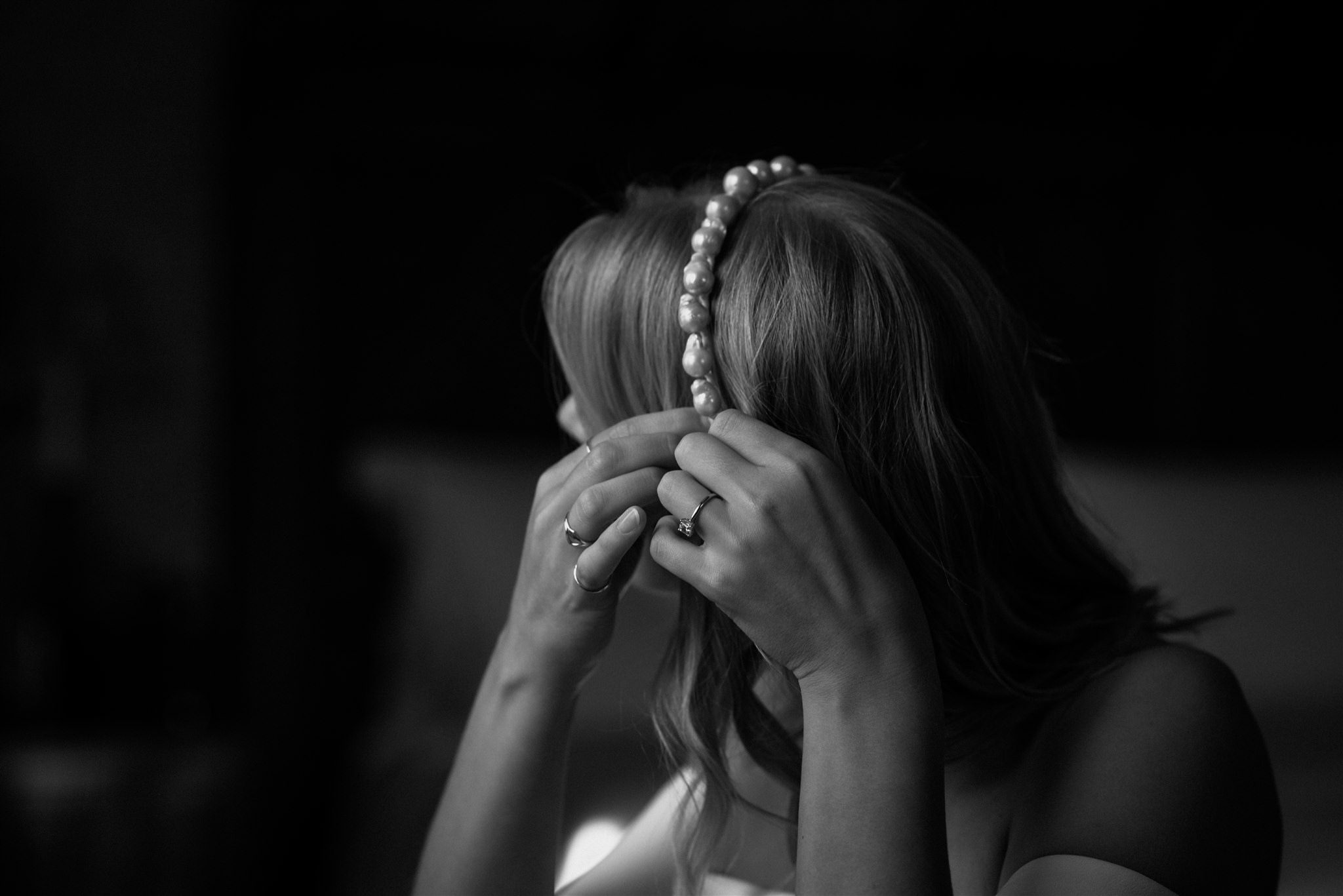 Bride putting on jewellery at The Fife Arms in Braemar