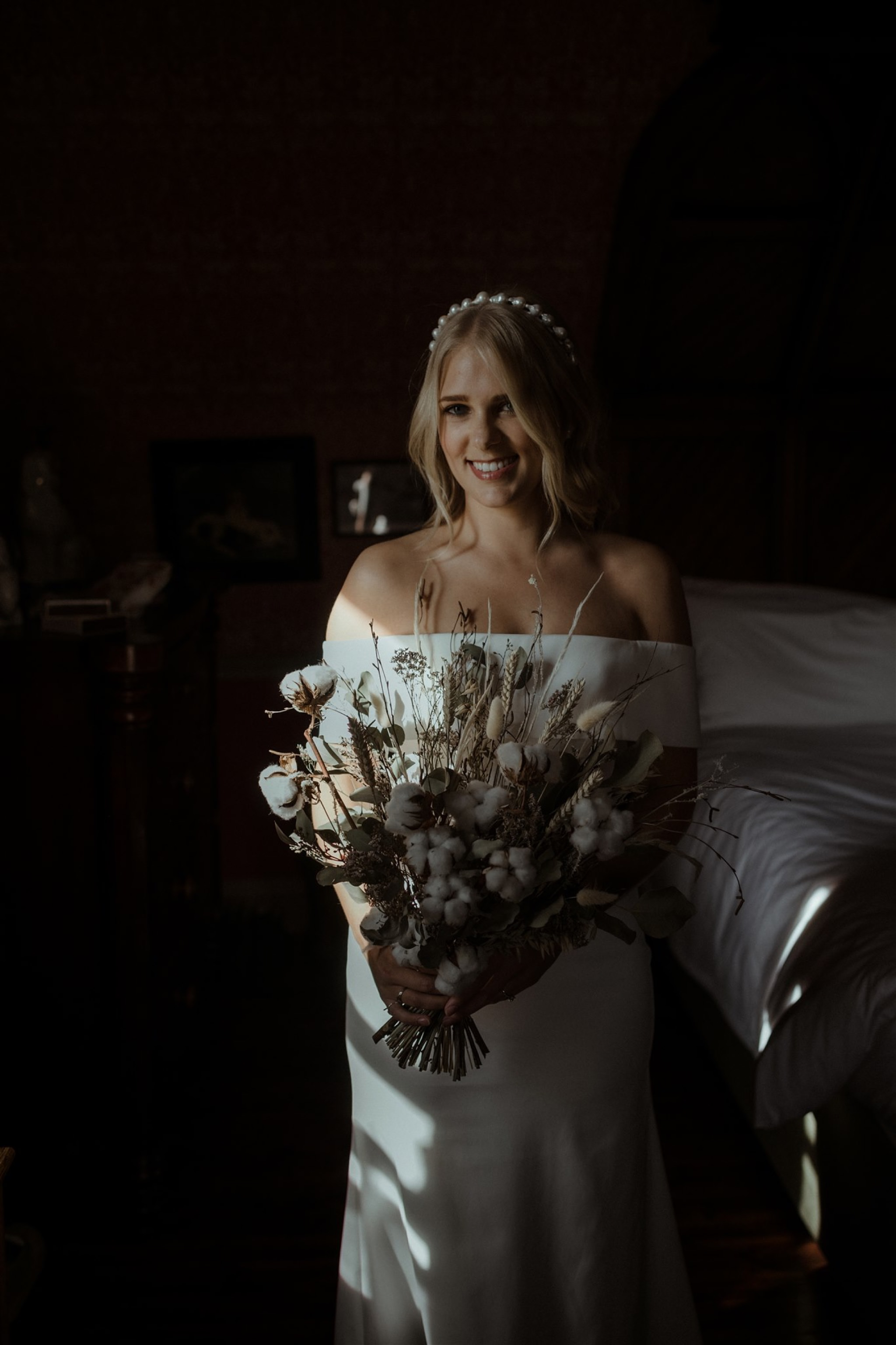 Bride with bouquet at The Fife Arms in Braemar