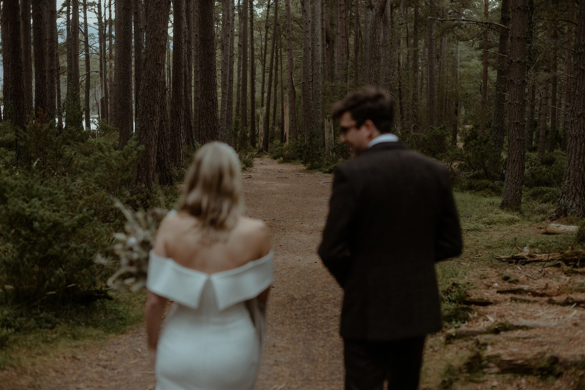 Bride and groom in the forest at Loch Garten