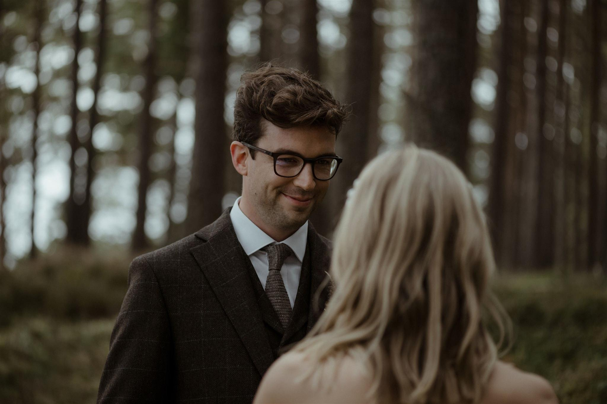 Bride and groom at woodland elopement ceremony at Loch Garten