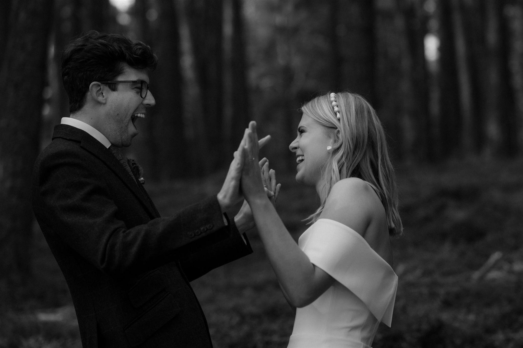 Bride and groom celebrate their Loch Garten elopement ceremony in the Cairngorms