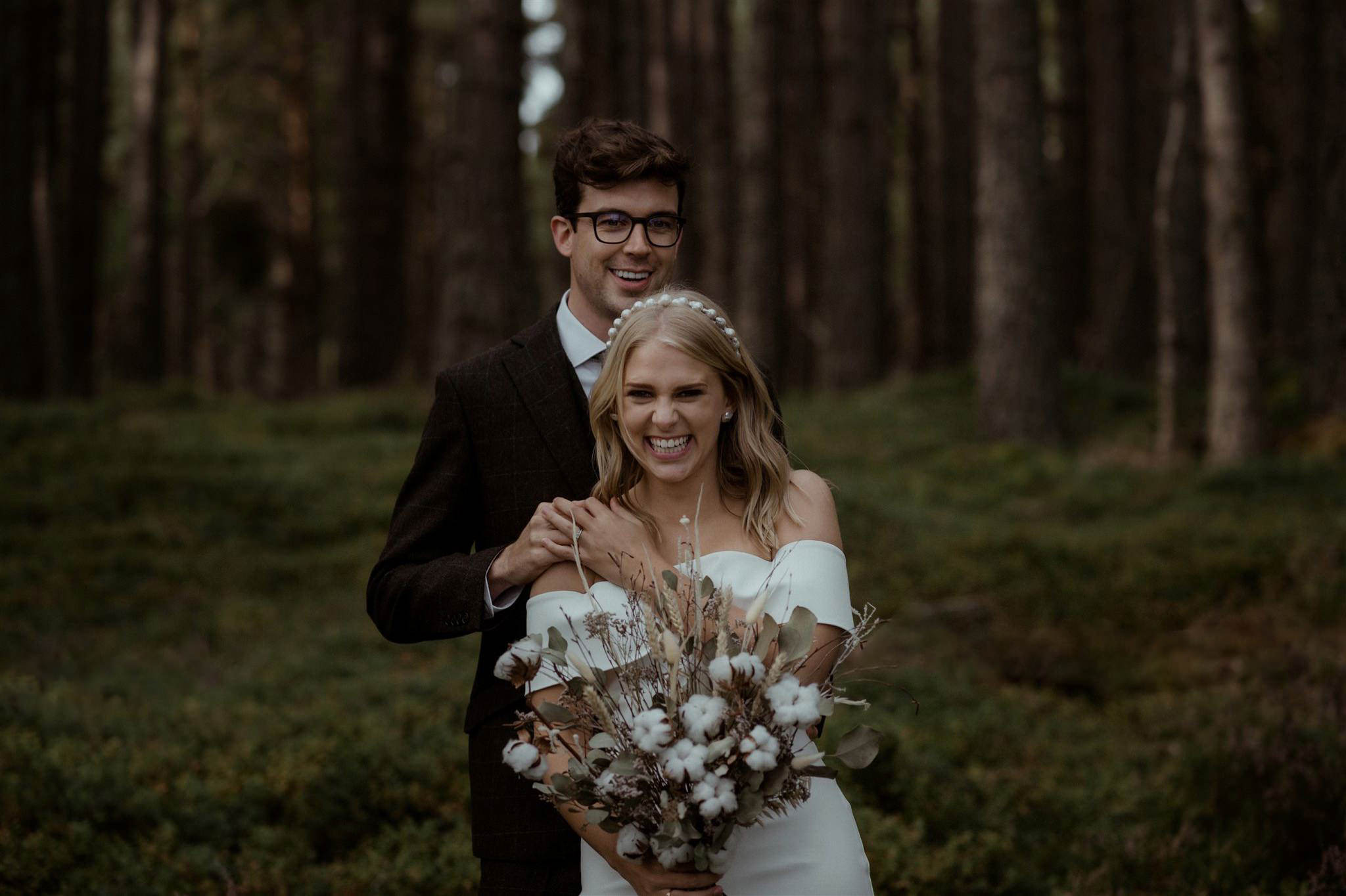 Bride and groom smiling at their Loch Garten elopement ceremony in the Cairngorms
