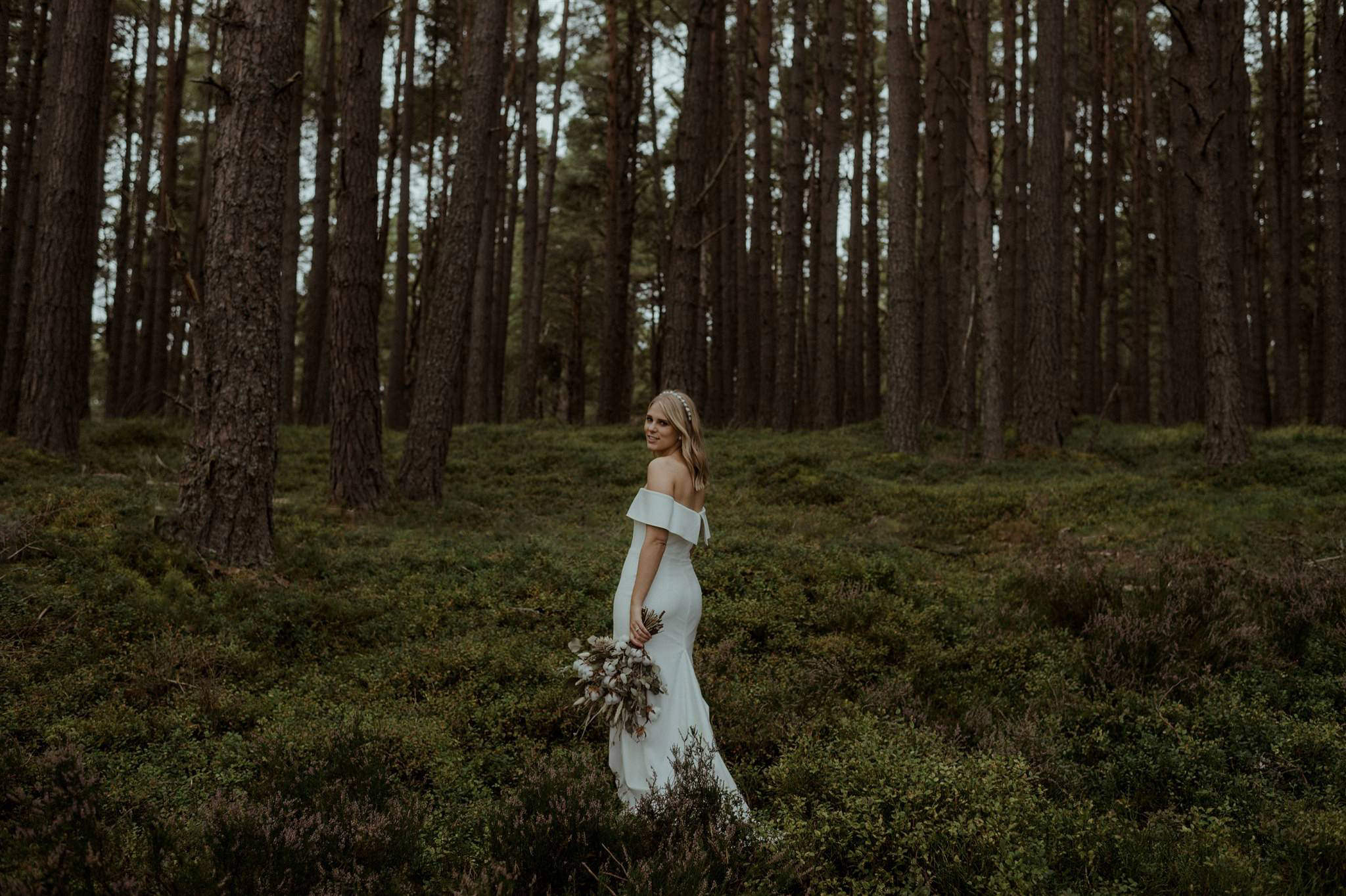 A bride at her woodland elopement ceremony in the Cairngorms