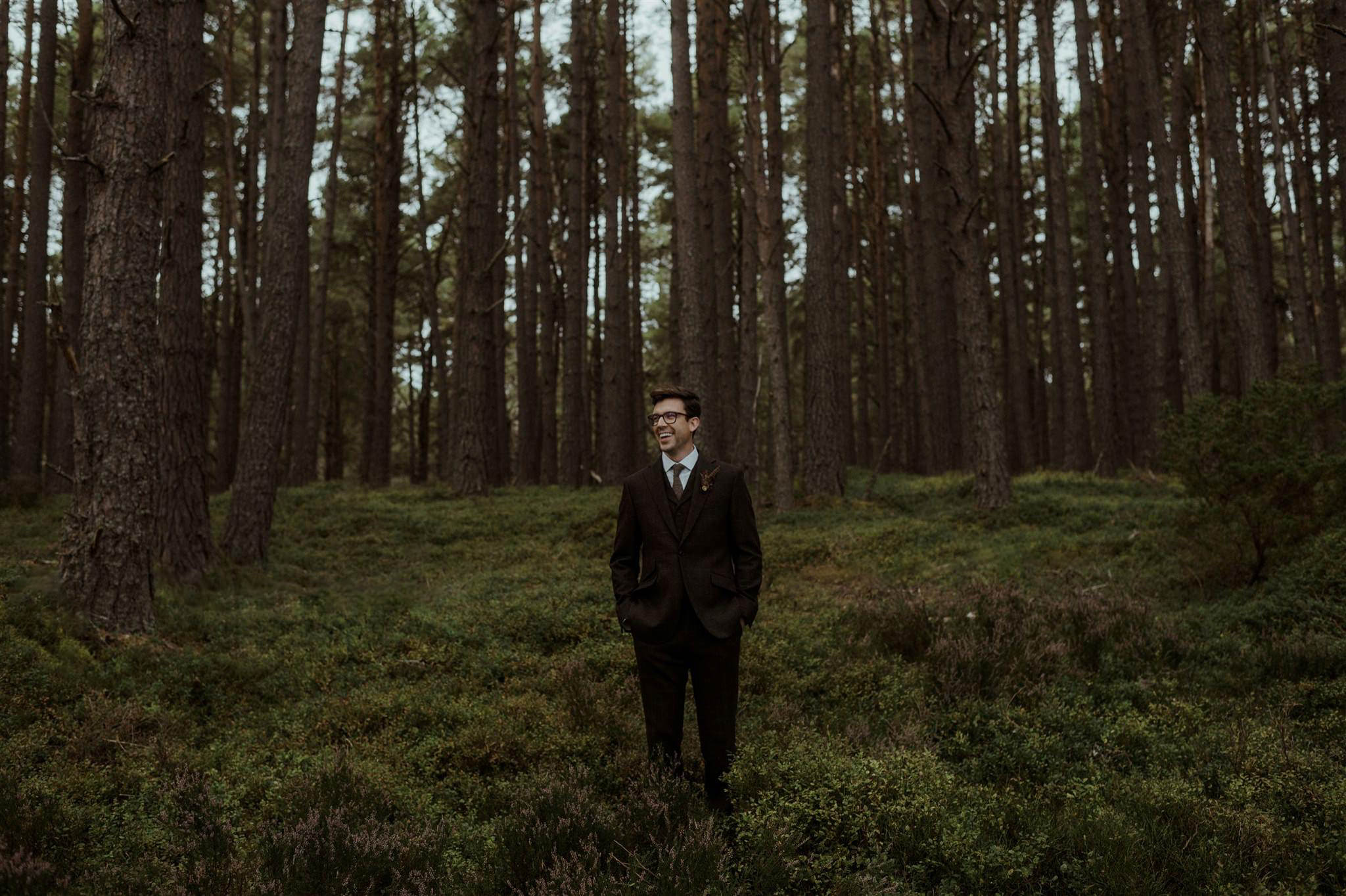 A groom at his woodland elopement ceremony in the Cairngorms
