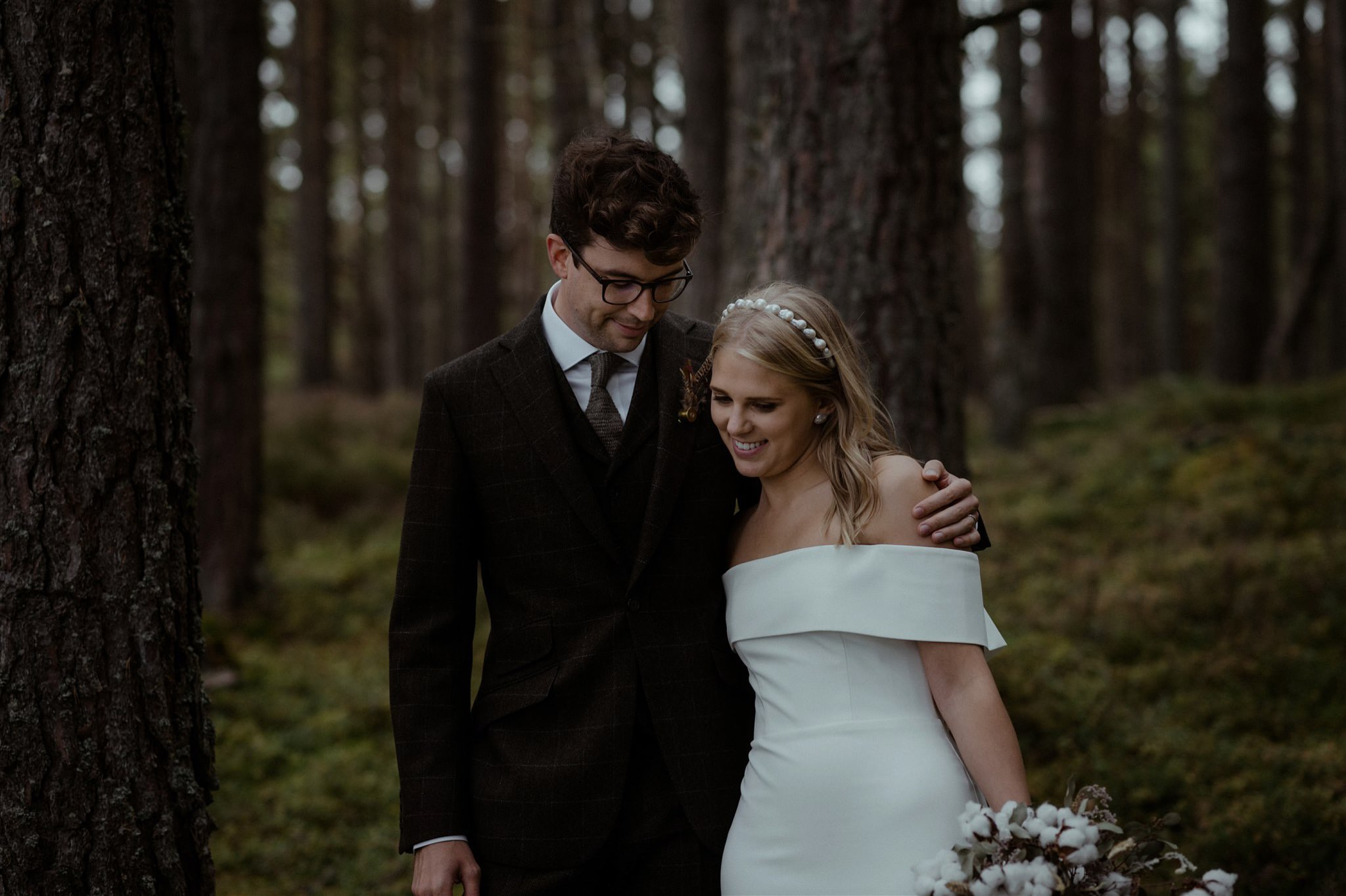 Bride and groom embrace at their Cairngorms woodland elopement ceremony