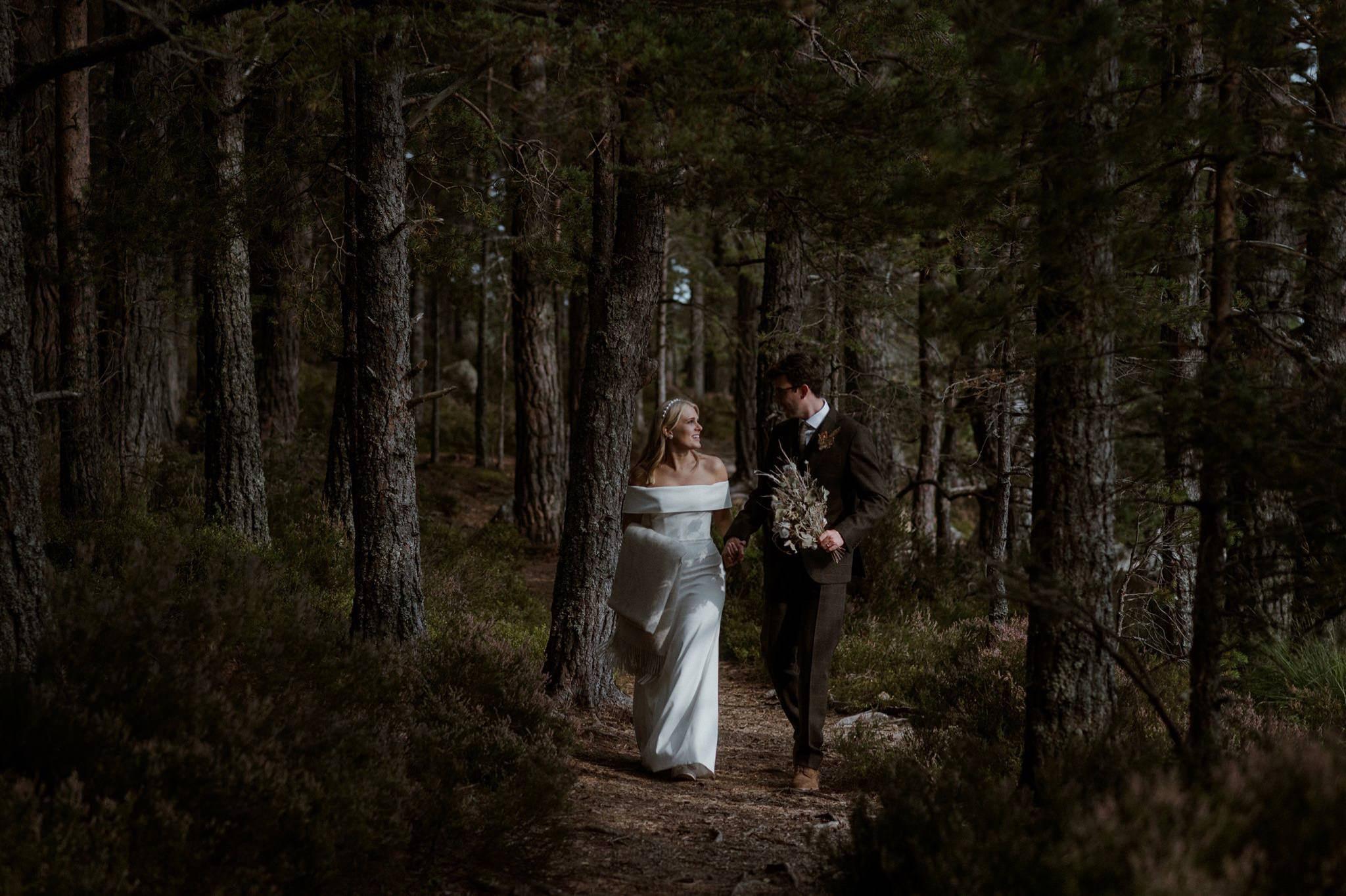 Bride and groom in woods at Loch Garten elopement