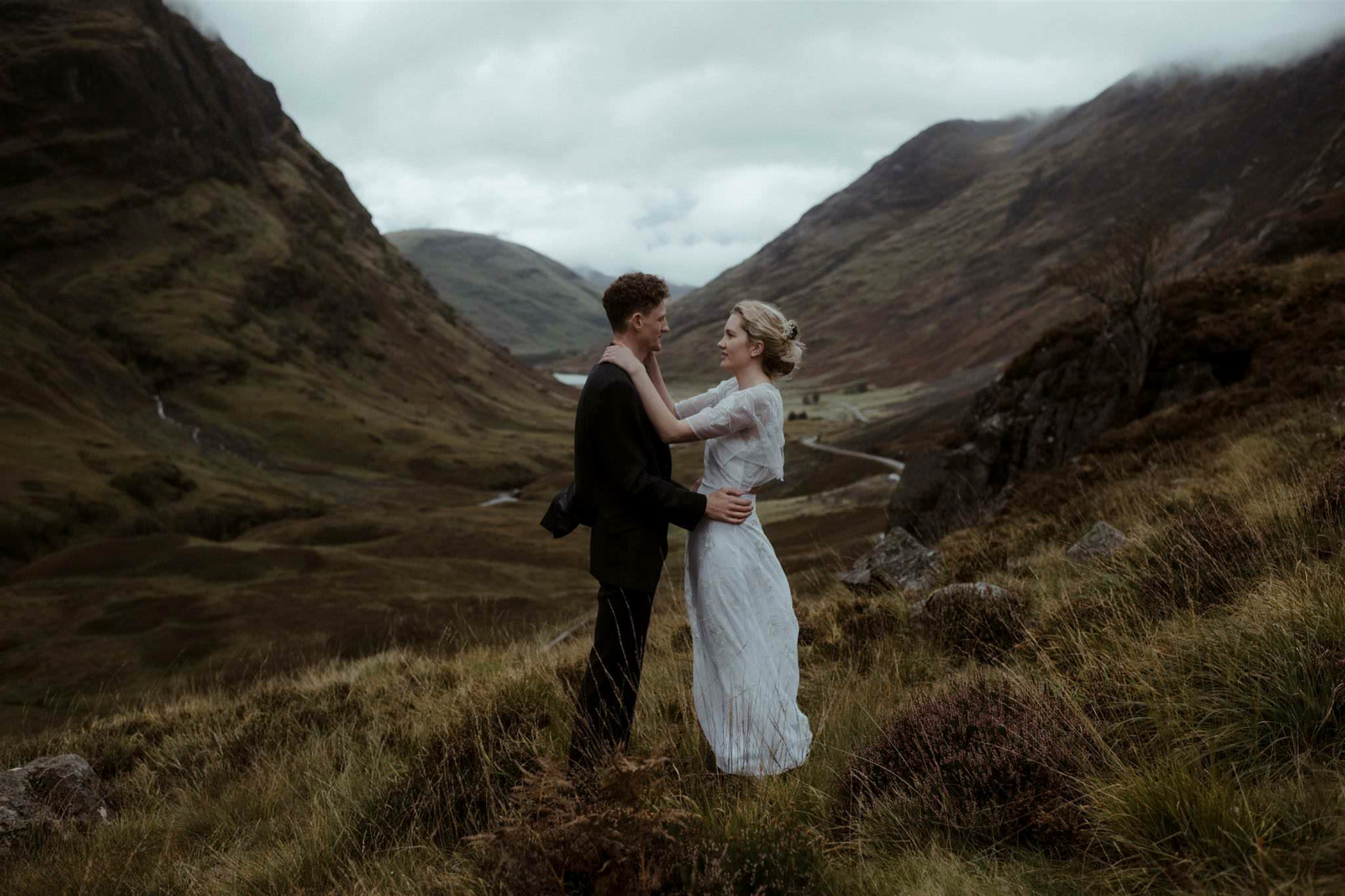 Bride and groom in the mountains at their Glencoe elopement wedding in Scotland