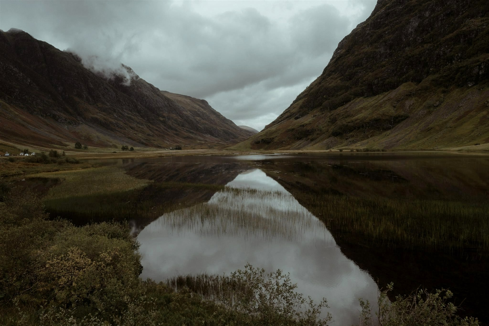 Loch with mountain reflections in Glencoe, Scotland