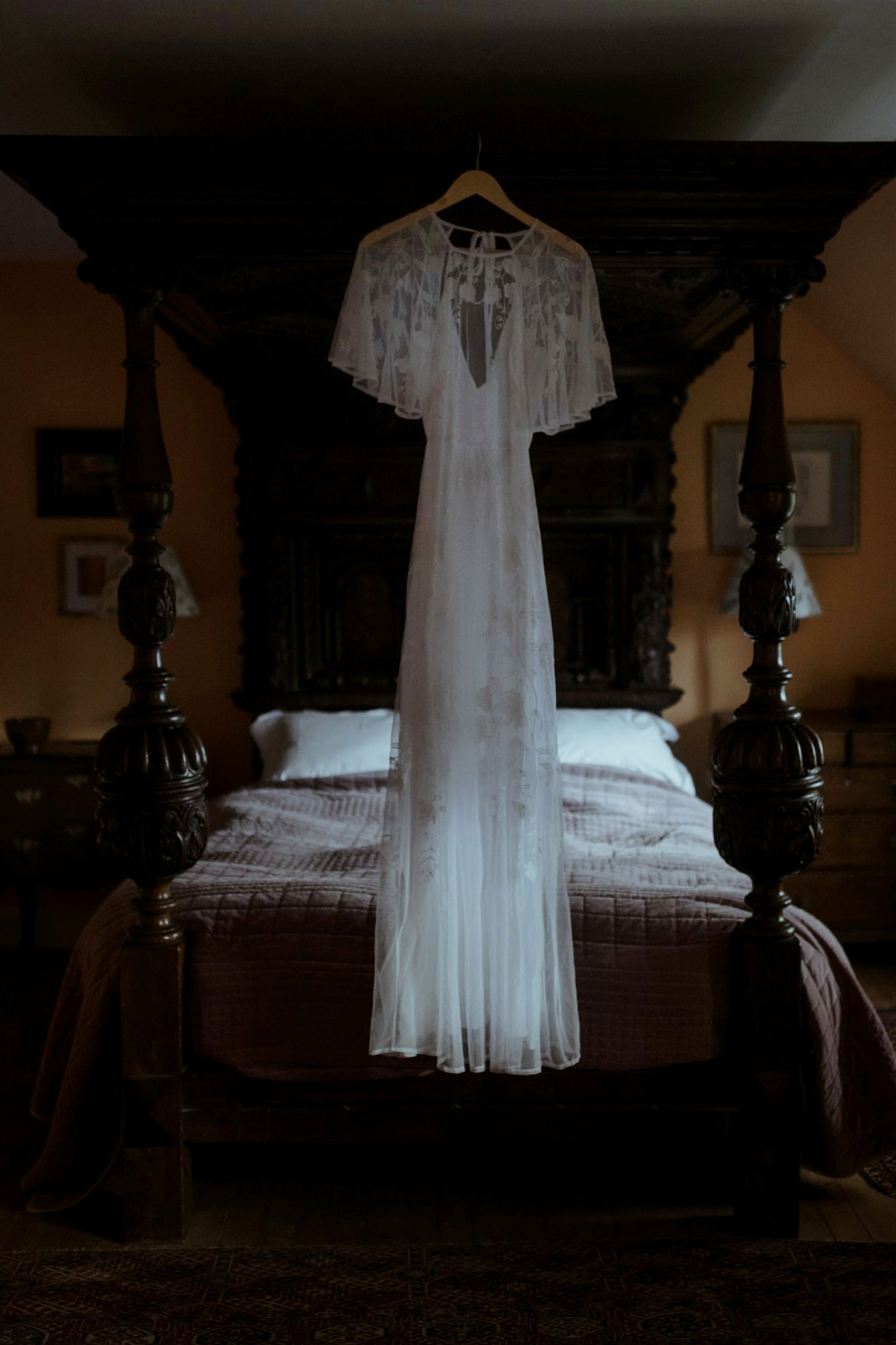Wedding dress hanging in bedroom Glencoe elopement accommodation