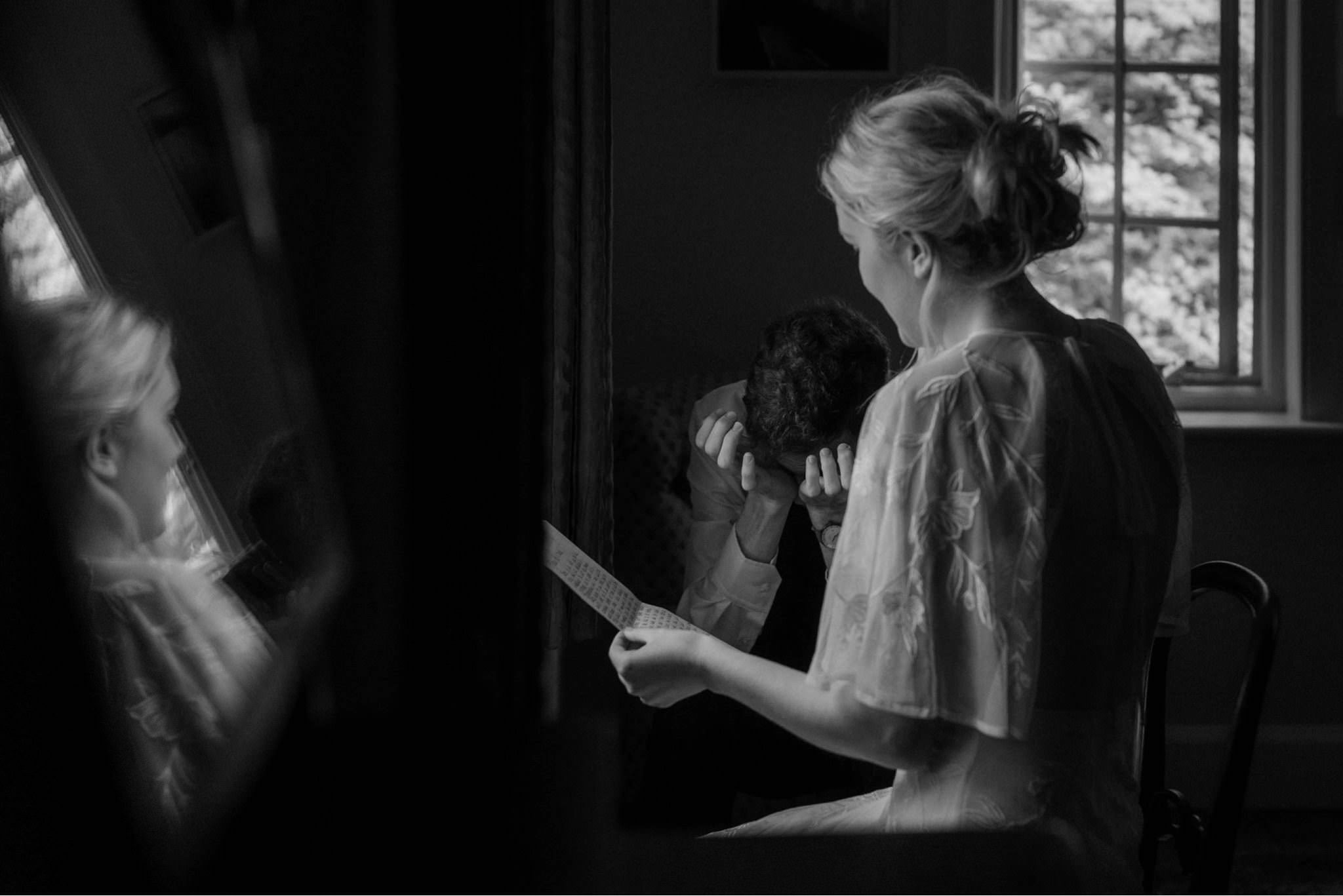 Bride and groom reading letters at their elopement in Glencoe, Scotland