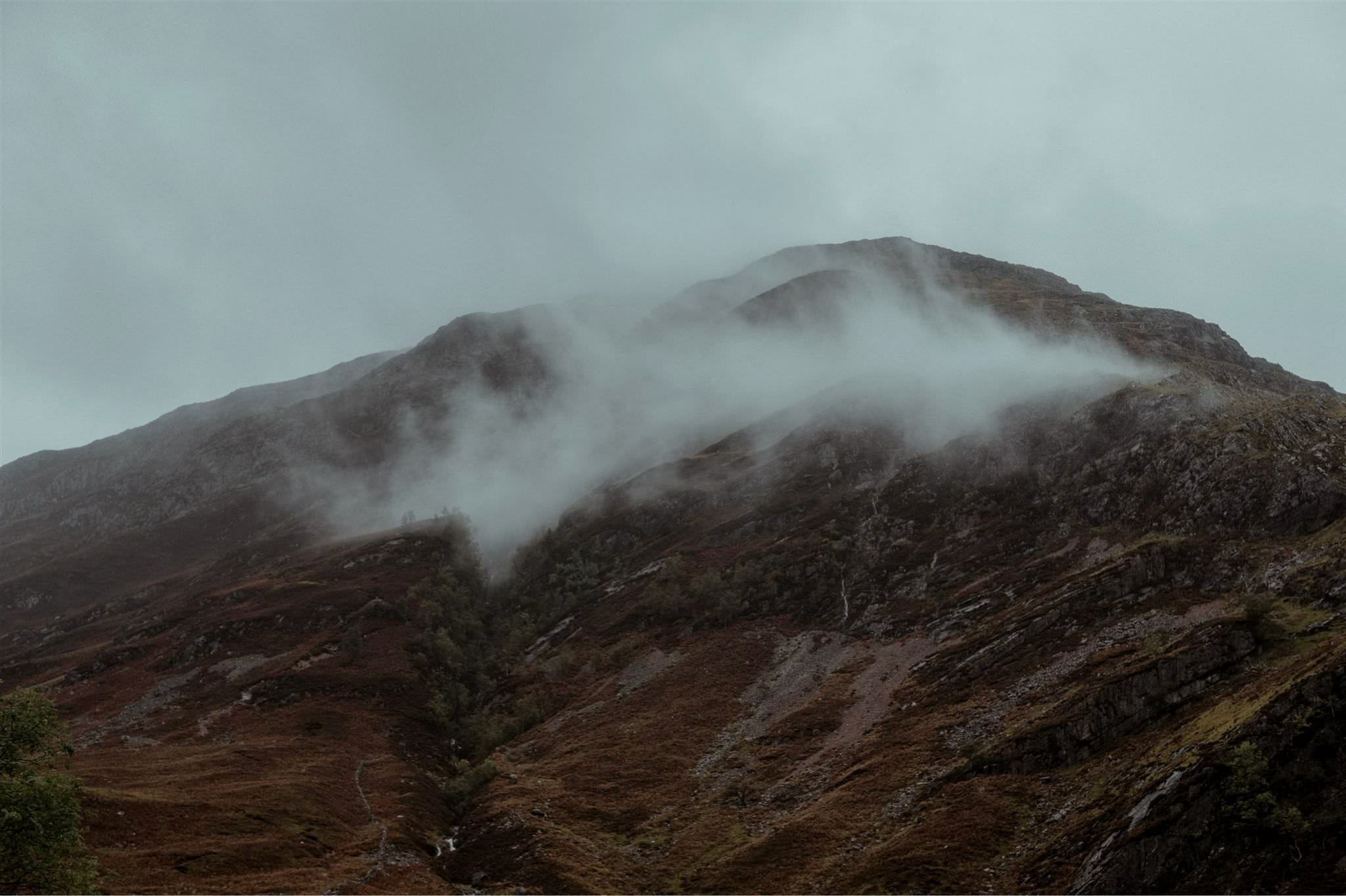 Misty mountains in Glencoe Scottish Highlands
