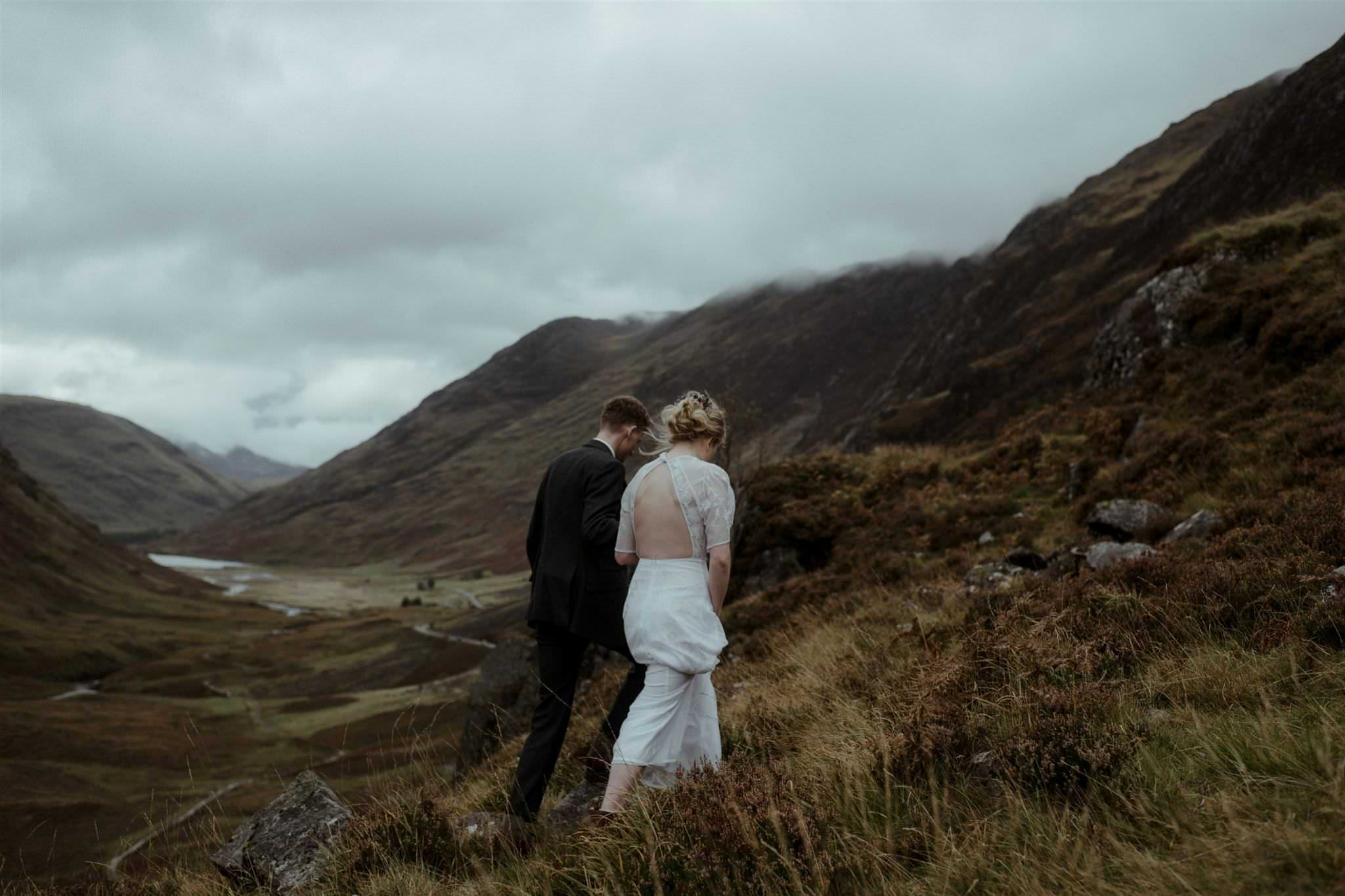 Couples walking hand-in-hand at their wedding for two in Scotland