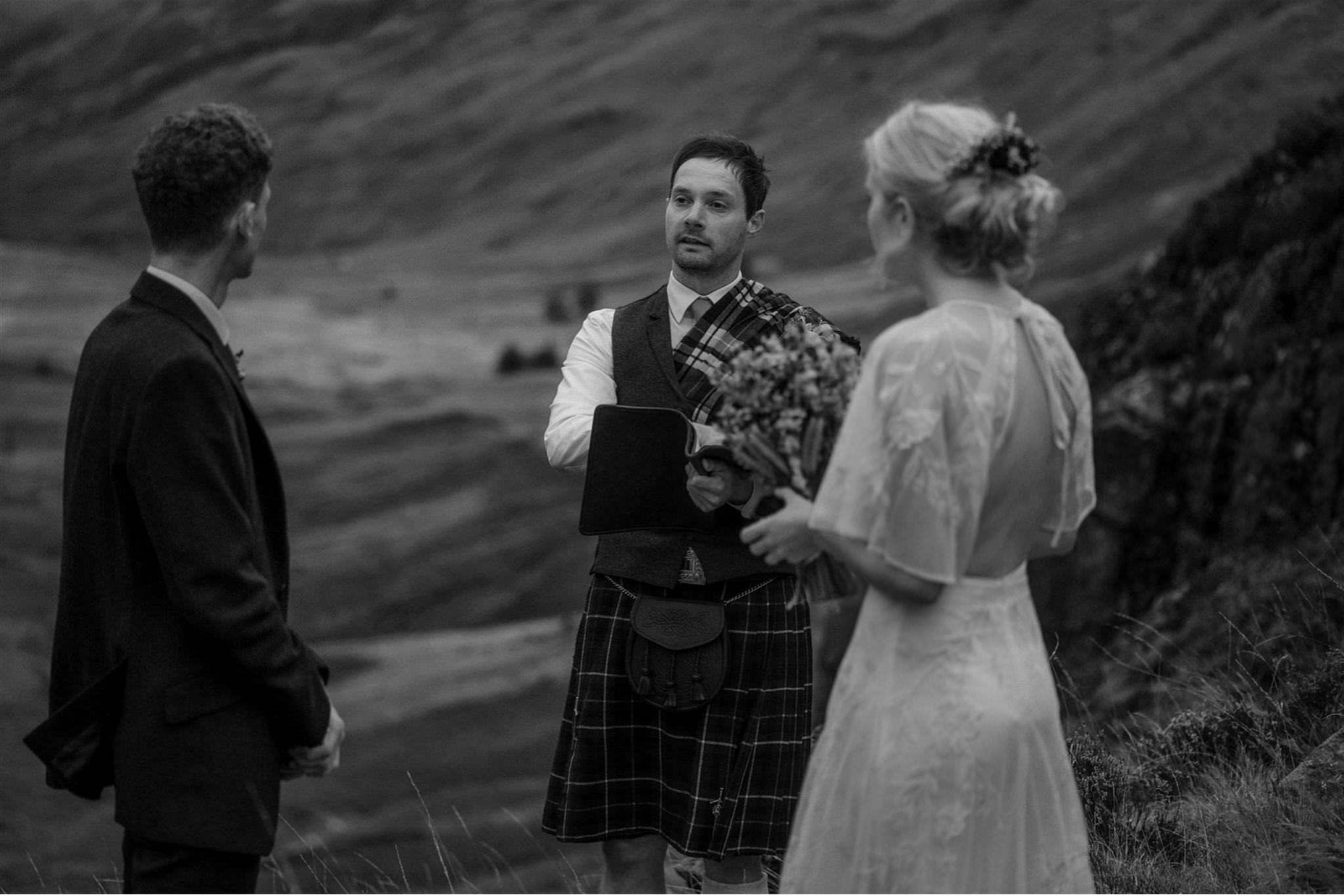 Humanist celebrant conducts an intimate outdoor elopement wedding ceremony in Glencoe Scotland
