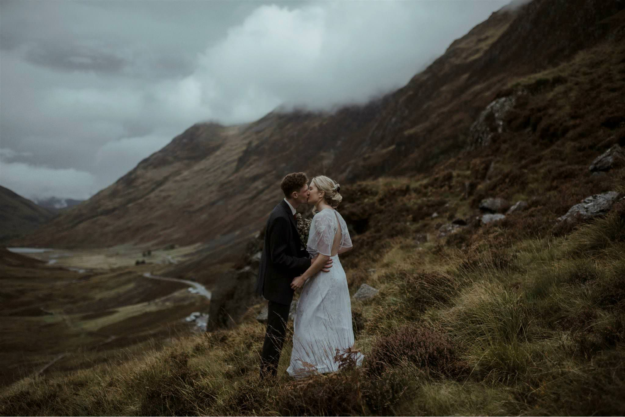 Bride and groom kiss during their Glencoe elopement in Scotland