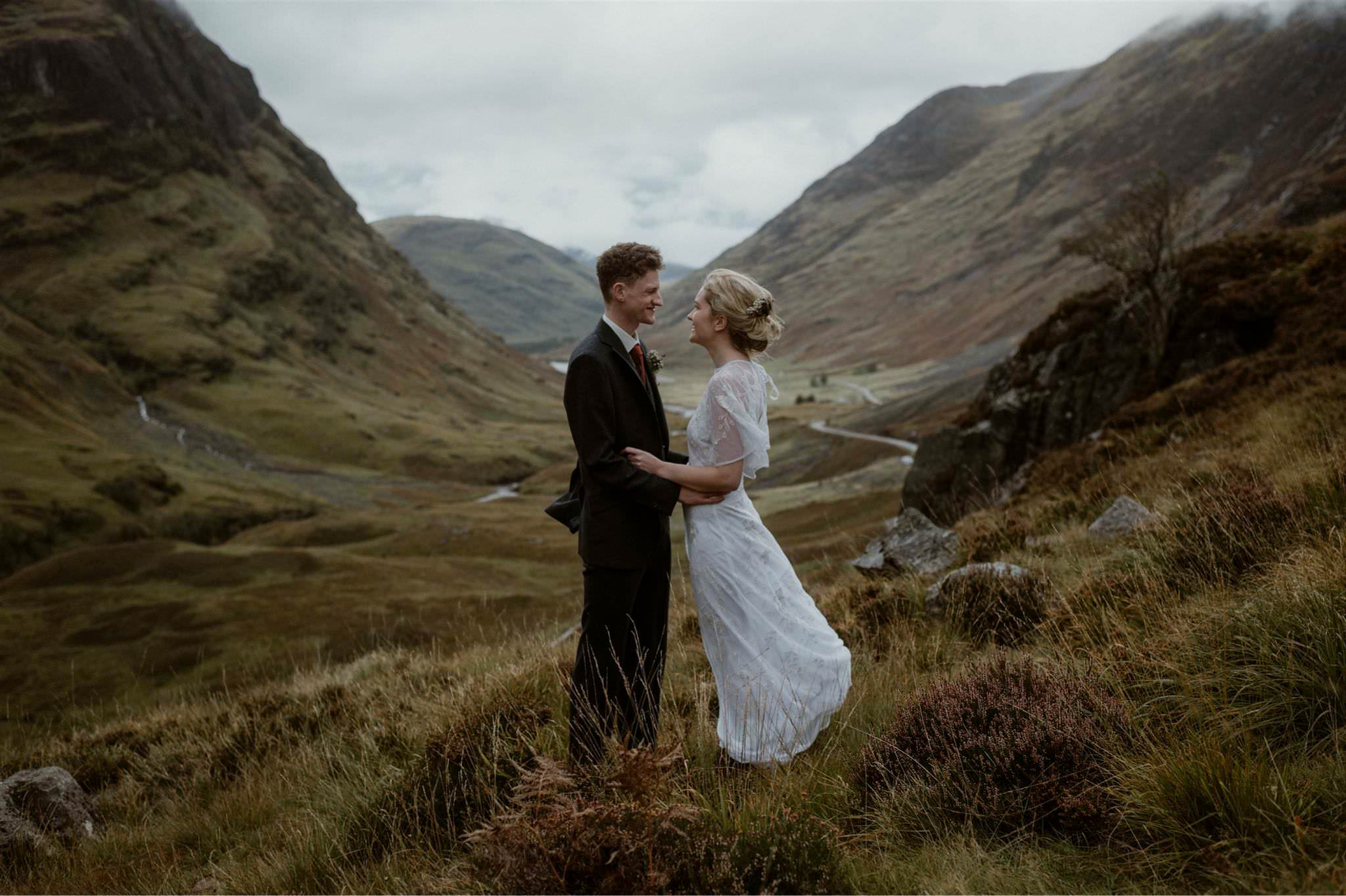 Bride and groom embrace after their Glencoe elopement wedding in Scotland