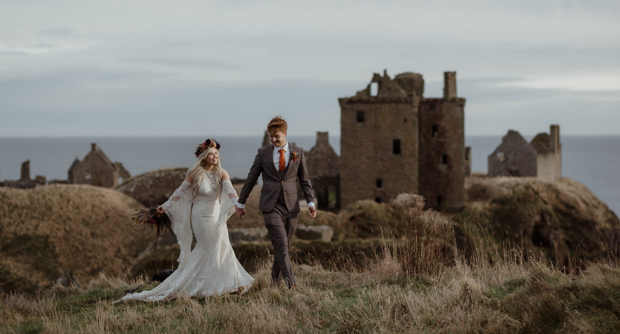 Bride and groom at an intimate elopement wedding at Dunnottar Castle in Scotland