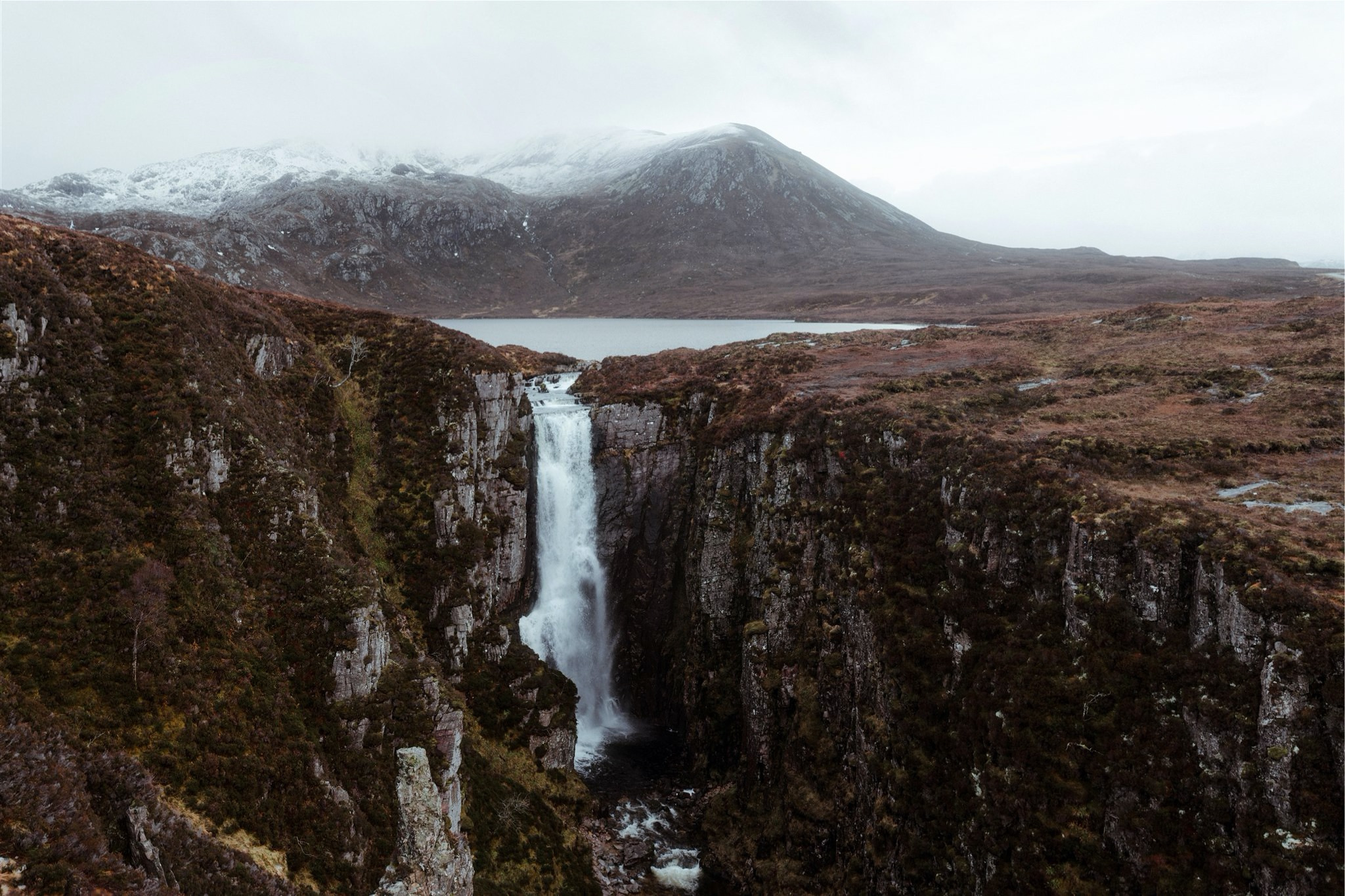 Waterfall with mountain backdrop in Assynt, Scotland