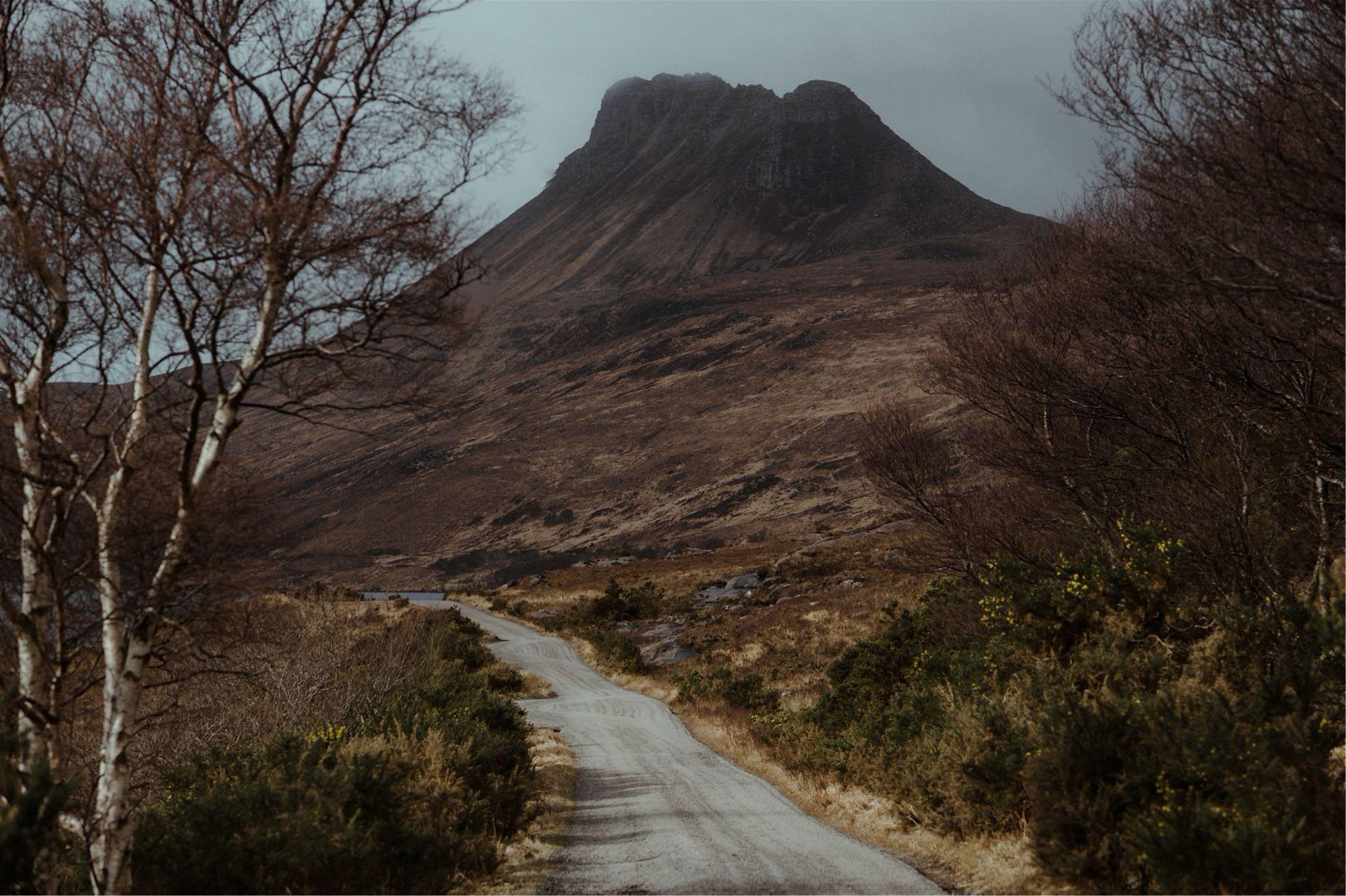 Road running towards a mountain in Assynt, Scotland