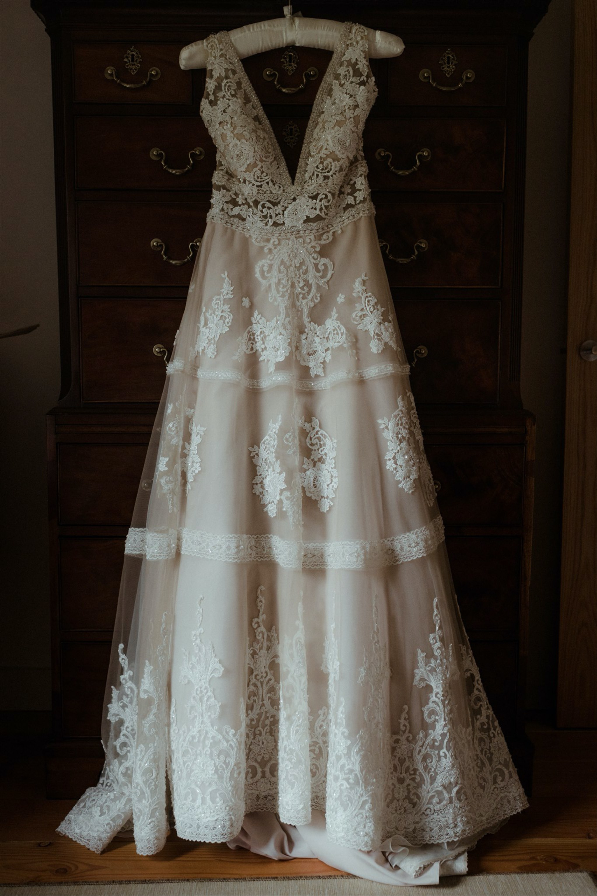 Wedding dress hanging in a bedroom for a Scottish elopement