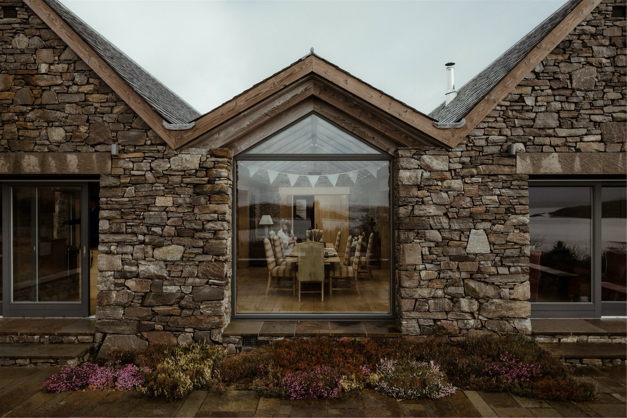 Exterior of stone cottage with large windows - elopement accommodation in Scotland