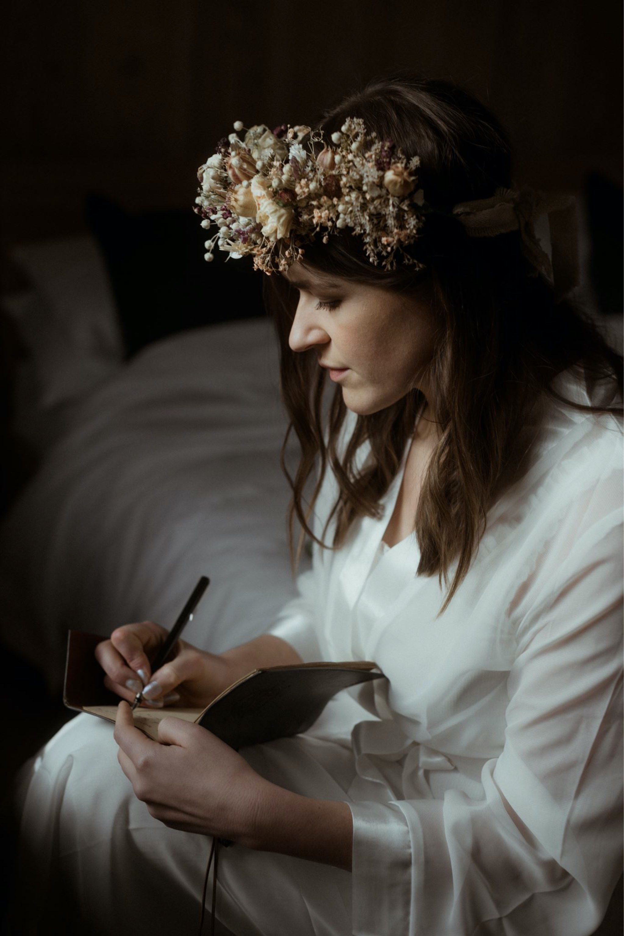 Bride writing her vows in a notebook before her Scotland elopement wedding